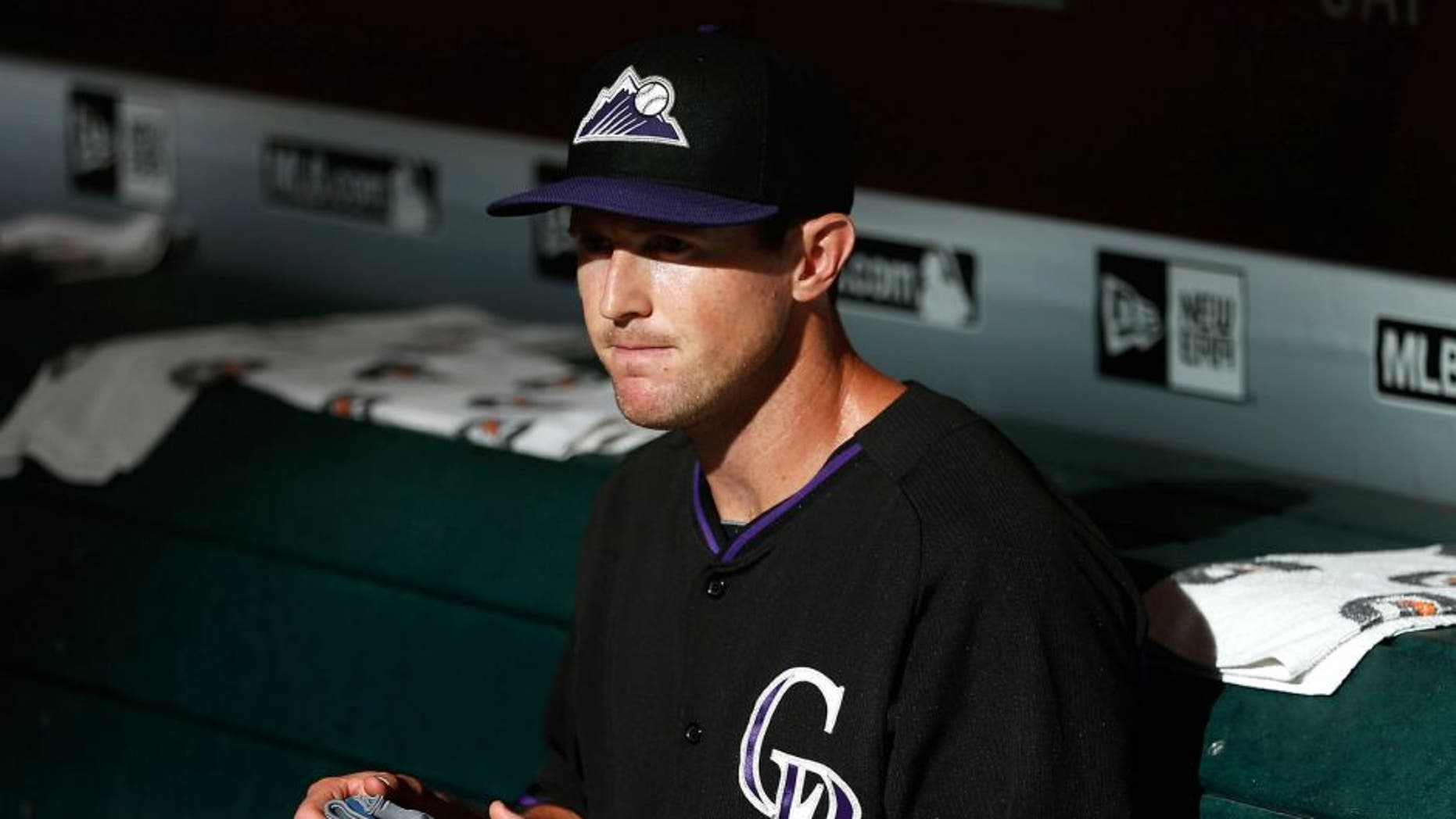 PHOENIX, AZ - JULY 03: Drew Stubbs #13 of the Colorado Rockies sits in the dugout before the MLB game against the Arizona Diamondbacks at Chase Field on July 3, 2015 in Phoenix, Arizona. (Photo by Christian Petersen/Getty Images)