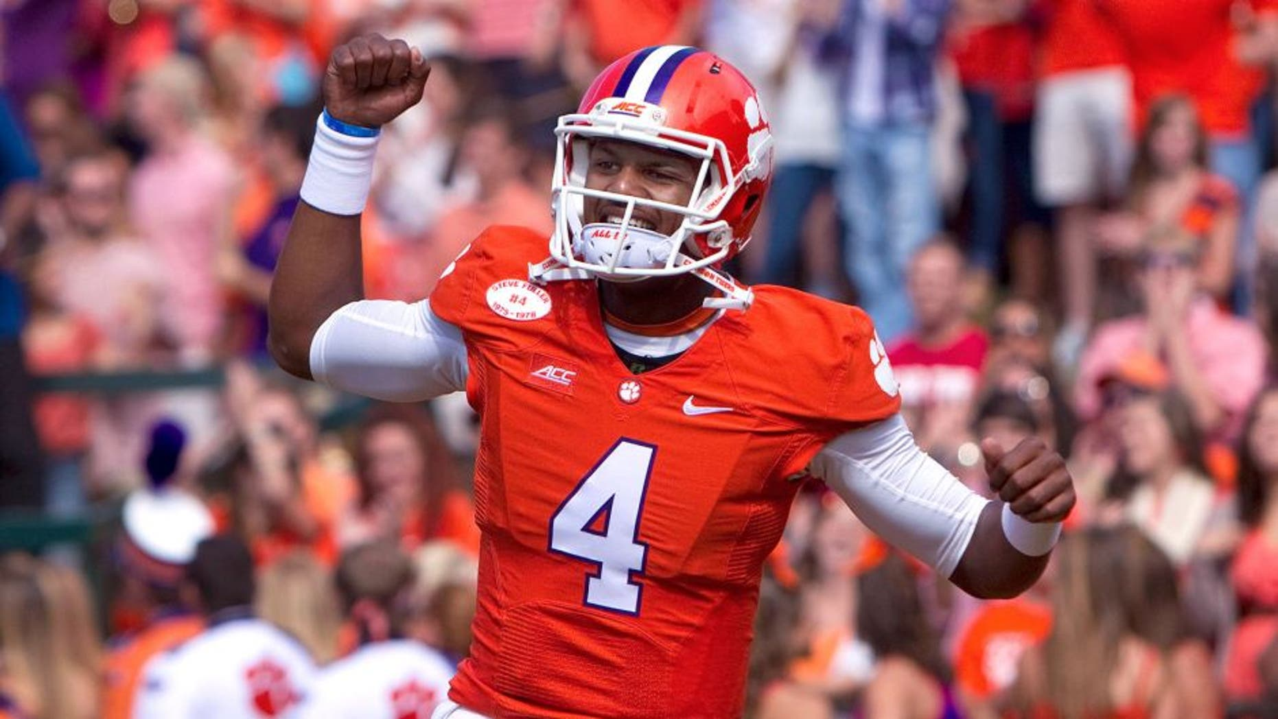 Oct 4, 2014; Clemson, SC, USA; Clemson Tigers quarterback Deshaun Watson (4) reacts during the first quarter against the North Carolina State Wolfpack at Clemson Memorial Stadium. Mandatory Credit: Joshua S. Kelly-USA TODAY Sports