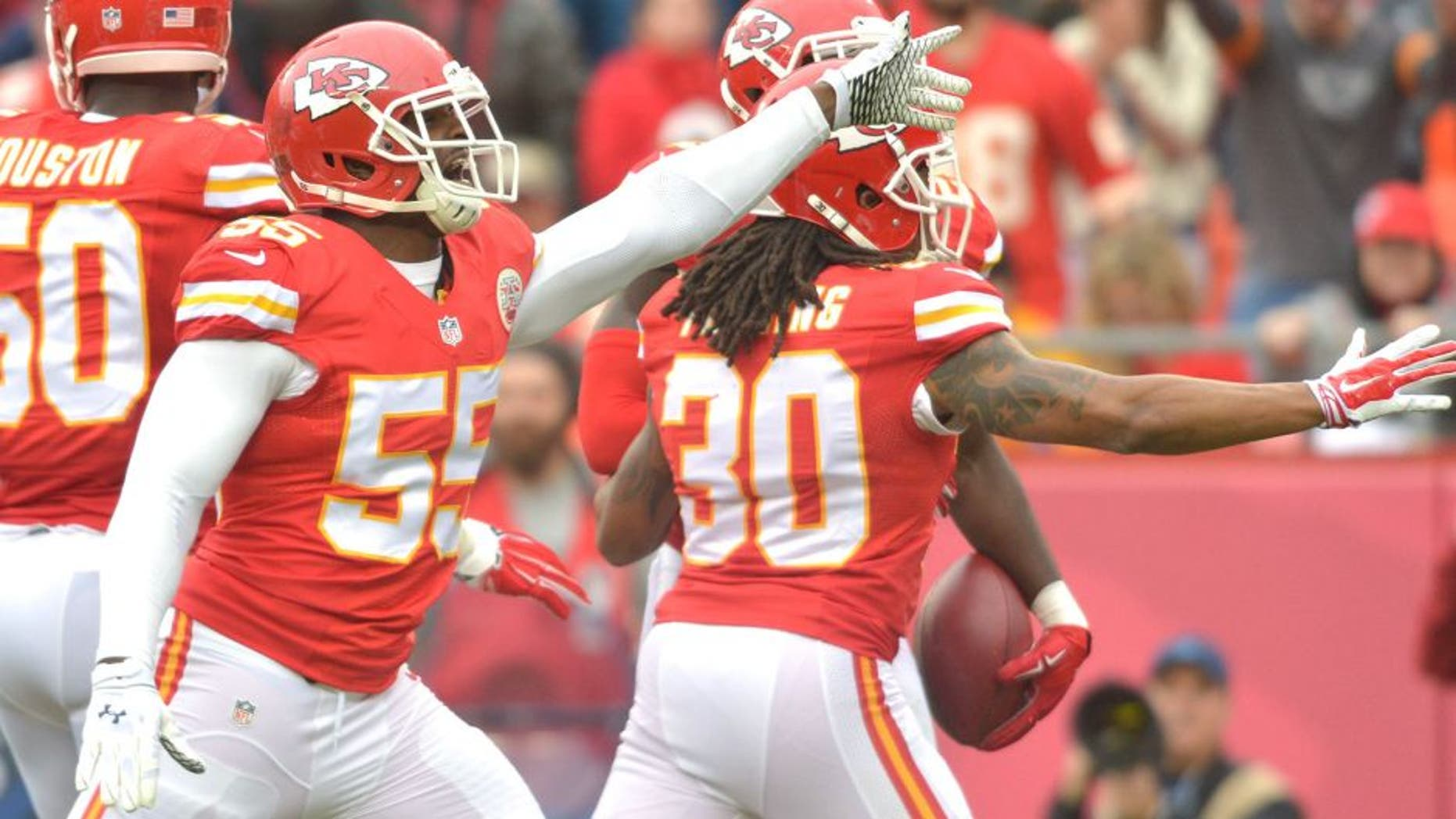 Dec 14, 2014; Kansas City, MO, USA; Kansas City Chiefs linebacker Dee Ford (55) and outside linebacker Justin Houston (50) celebrate after a play during the first half against the Oakland Raiders at Arrowhead Stadium. The Chiefs won 31-13. Mandatory Credit: Denny Medley-USA TODAY Sports
