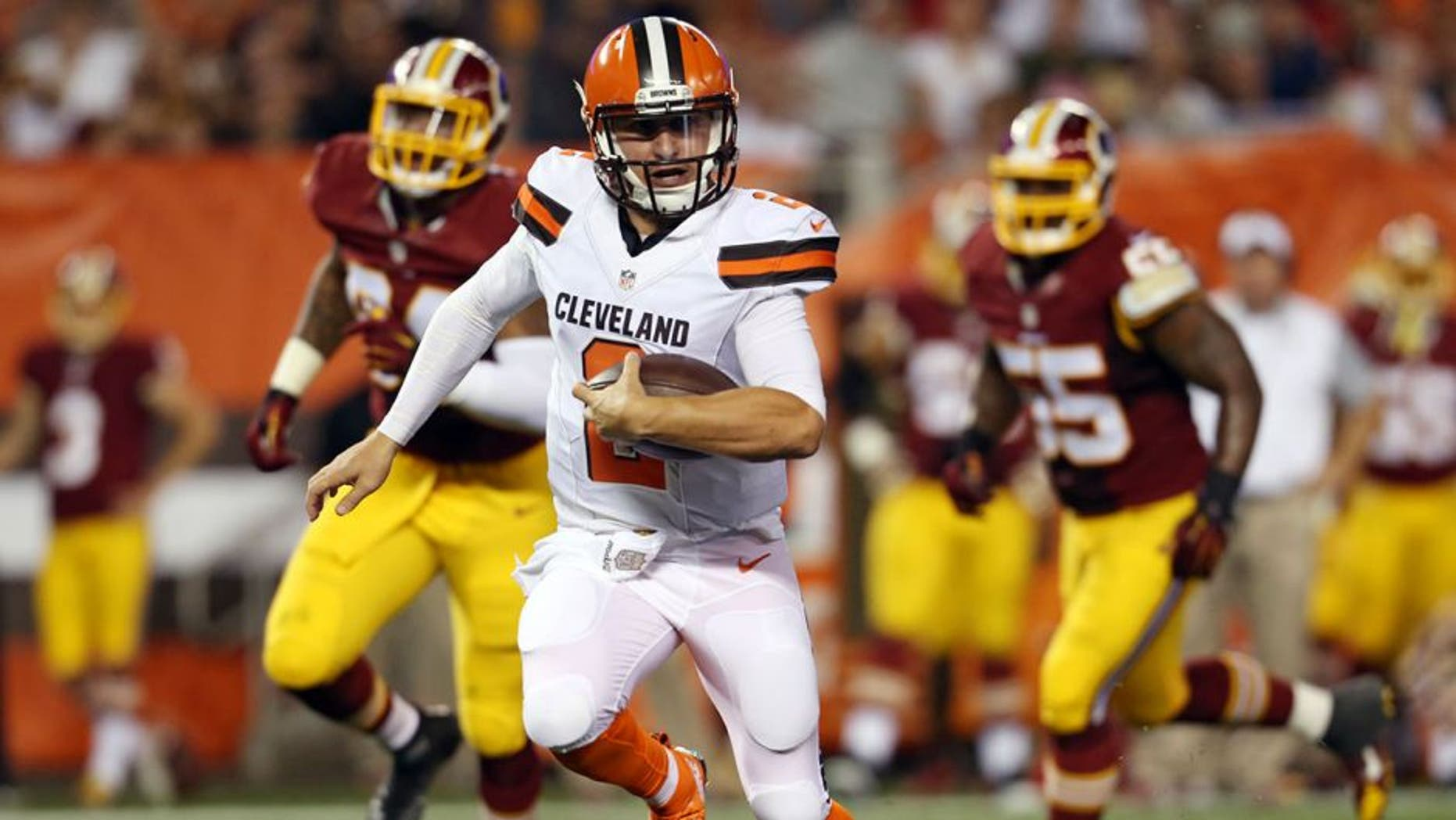 Cleveland Browns quarterback Johnny Manziel (2) scrambles for a 12-yard touchdown during the second quarter of an NFL preseason football game against the Washington Redskins, Thursday, Aug. 13, 2015, in Cleveland. (AP Photo/Ron Schwane)