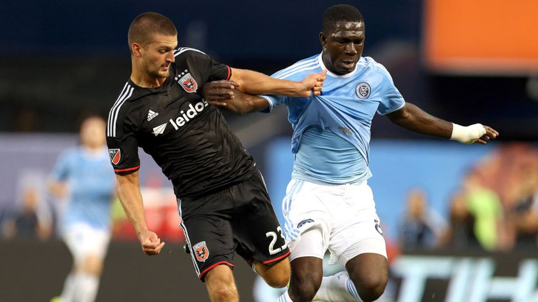 Aug 13, 2015; New York, NY, USA; New York City FC midfielder Kwadwo Poku (88) battles for the ball with D.C. United midfielder Perry Kitchen (23) during the first half of their soccer match at Yankee Stadium. Mandatory Credit: Adam Hunger-USA TODAY Sports