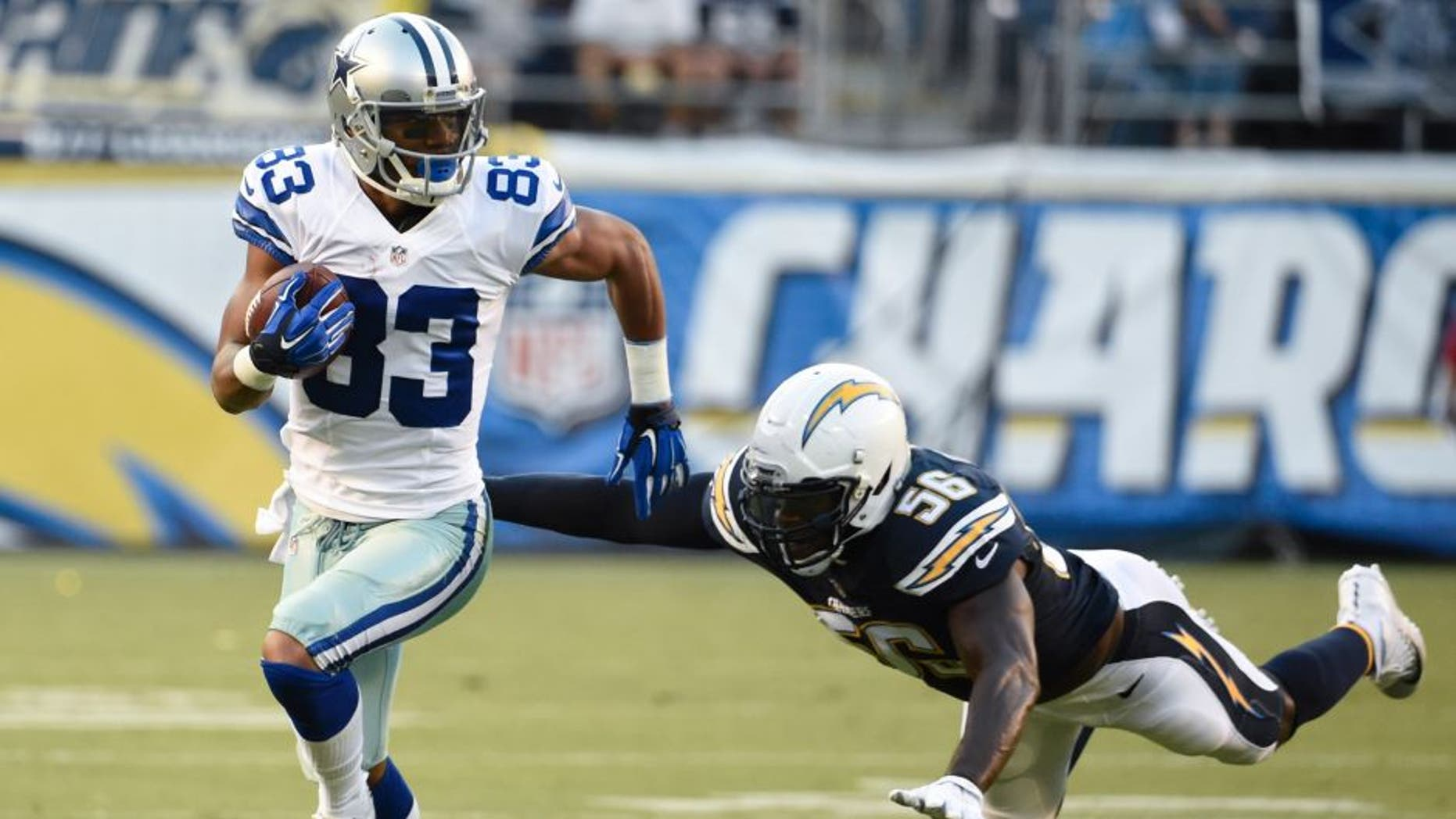 Dallas Cowboys wide receiver Terrance Williams runs upfield after a completion as San Diego Chargers inside linebacker Donald Butler defends during the first half of an NFL preseason football game Thursday, Aug. 13, 2015 in San Diego. (AP Photo/Denis Poroy)