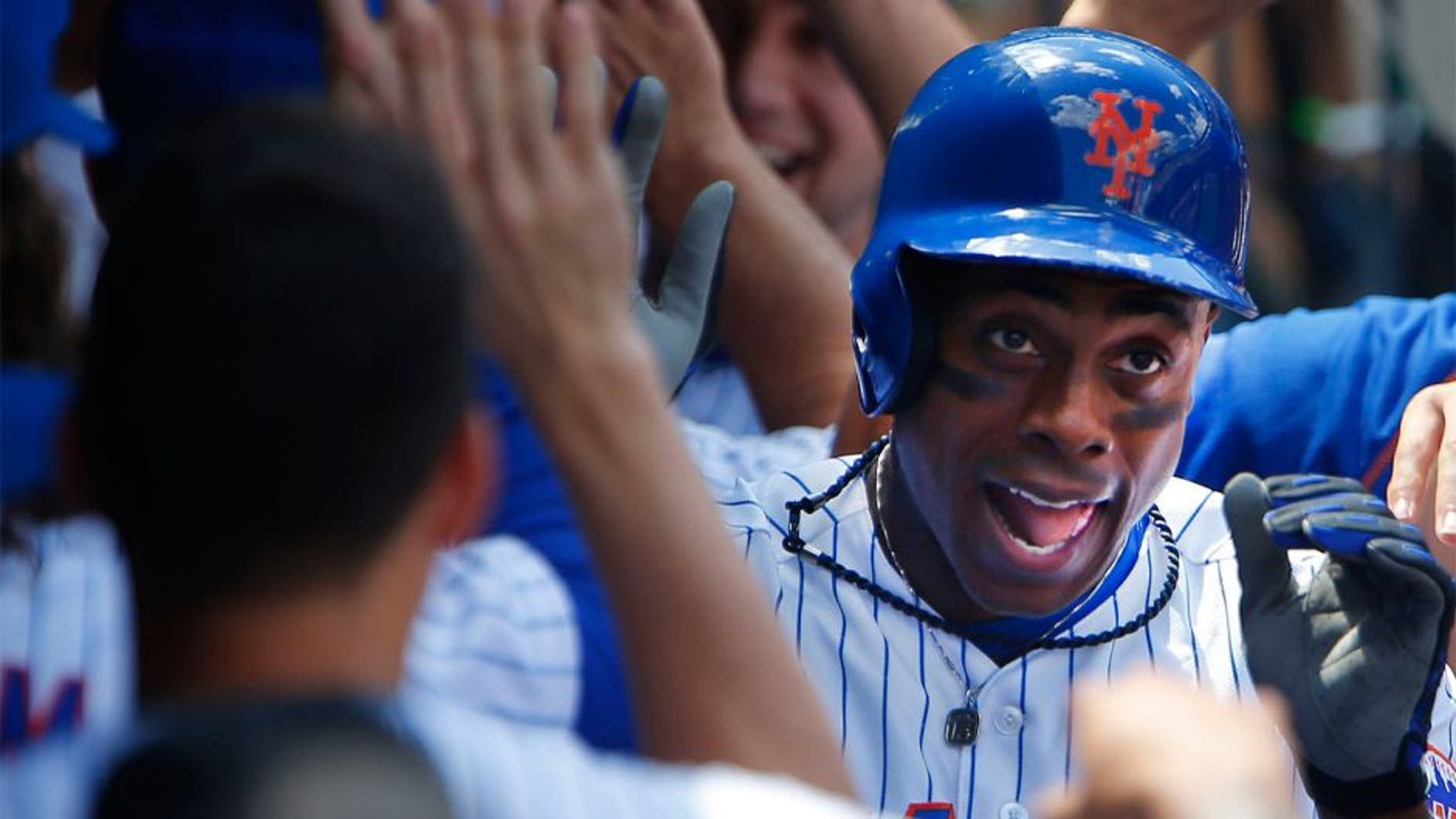 Aug 13, 2015; New York City, NY, USA; New York Mets right fielder Curtis Granderson (3) is congratulated in the dugout by teammates after his two run home run in the fourth inning against the Colorado Rockies at Citi Field. Mandatory Credit: Noah K. Murray-USA TODAY Sports
