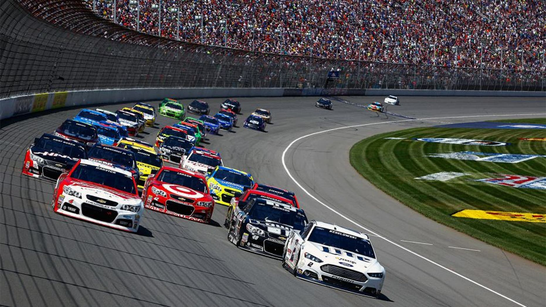 BROOKLYN, MI - JUNE 15: Kevin Harvick, driver of the #4 Budweiser Chevrolet, and Brad Keselowski, driver of the #2 Miller Lite Ford, lead the field on a restart during the NASCAR Sprint Cup Series Quicken Loans 400 at Michigan International Speedway on June 15, 2014 in Brooklyn, Michigan. (Photo by Brian Lawdermilk/NASCAR via Getty Images)
