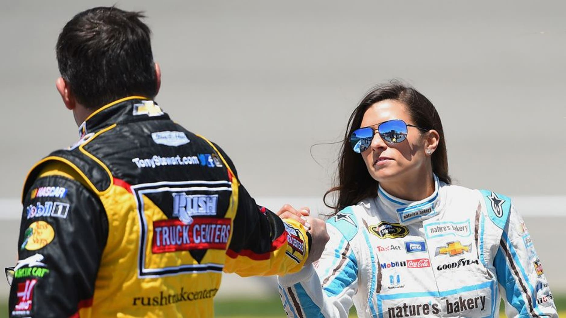 BROOKLYN, MI - JUNE 12: (L-R) Tony Stewart, driver of the #14 Rush Truck Centers/Mobil 1 Chevrolet, talks to Danica Patrick, driver of the #10 Nature's Bakery Chevrolet, on the grid prior to the NASCAR Sprint Cup Series FireKeepers Casino 400 at Michigan International Speedway on June 12, 2016 in Brooklyn, Michigan. (Photo by Josh Hedges/Getty Images )