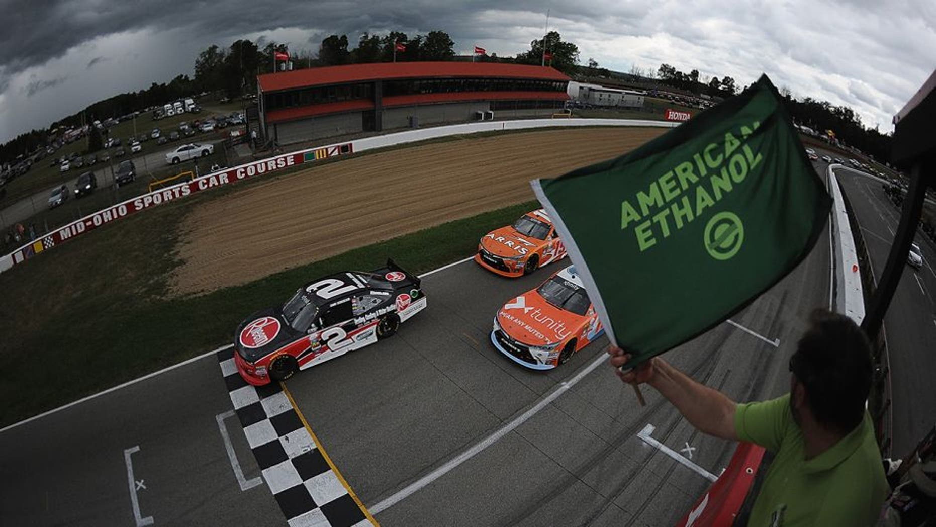 LEXINGTON, OH - AUGUST 13: Sam Hornish Jr., driver of the #2 Rheem Chevrolet and Owen Kelly, driver of the #18 Tunity Toyota, lead at the start of the 4th annual NASCAR XFINITY Series Mid-Ohio Challenge at Mid-Ohio Sports Car Course on August 13, 2016 in Lexington, Ohio. (Photo by Jonathan Moore/Getty Images)