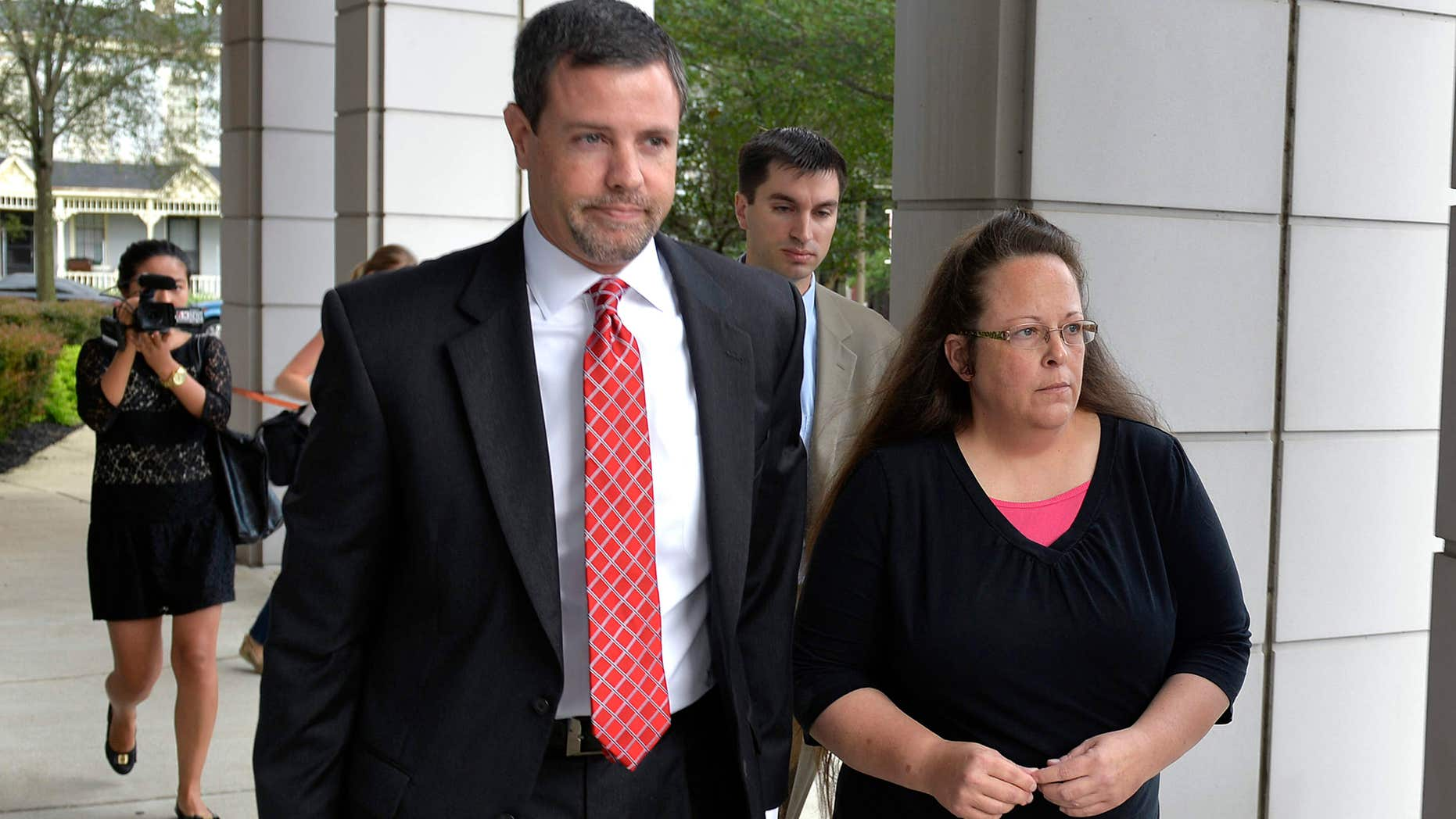 July 20, 2015: Rowan County Clerk Kim Davis, right, walks with her attorney Roger Gannam into the United States District Court for the Eastern District of Kentucky in Covington, Ky.