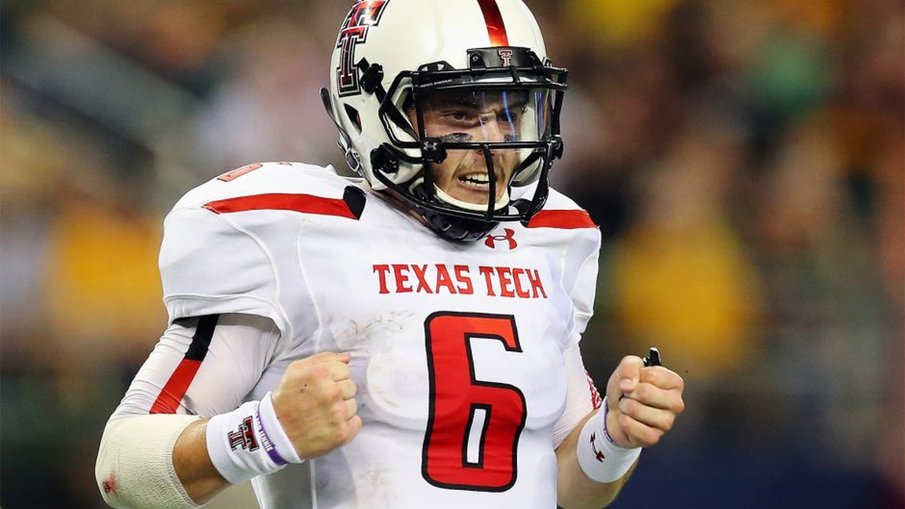 ARLINGTON, TX - NOVEMBER 16: Baker Mayfield #6 of the Texas Tech Red Raiders celebrates his second touchdown pass against the Baylor Bears at AT&T Stadium on November 16, 2013 in Arlington, Texas. (Photo by Ronald Martinez/Getty Images)