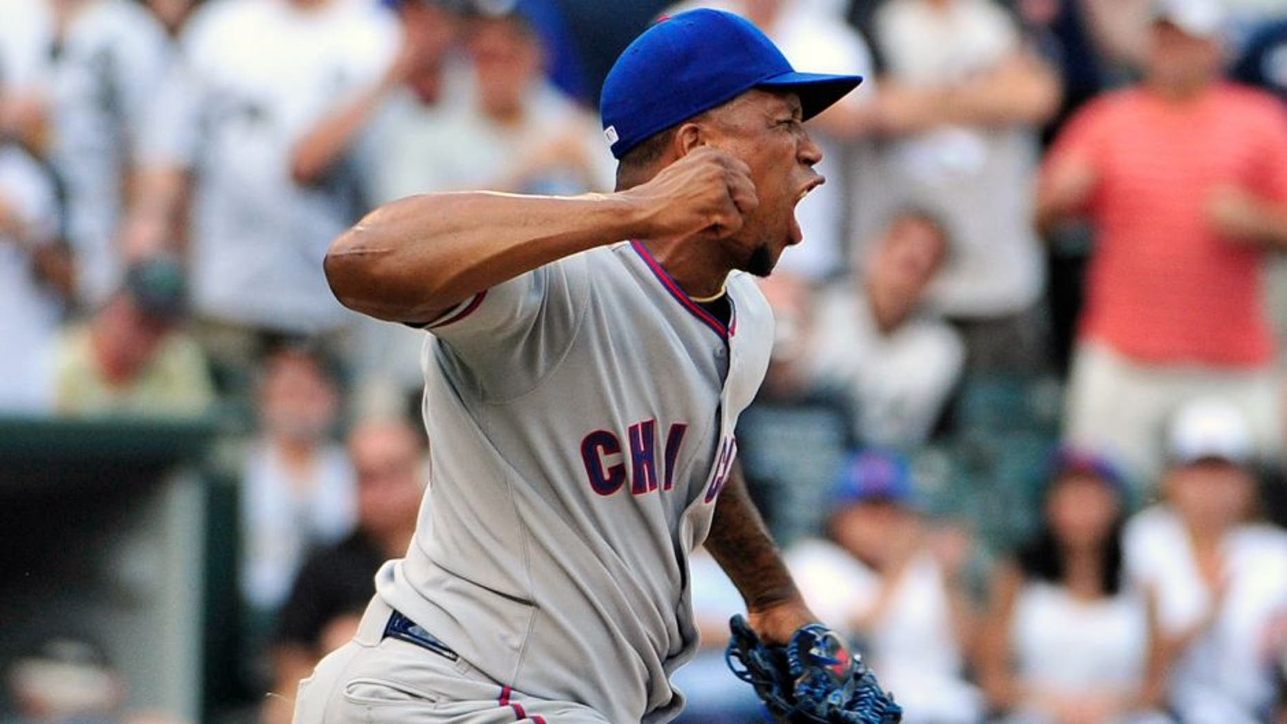 Aug 14, 2015; Chicago, IL, USA; Chicago Cubs relief pitcher Pedro Strop (46) reacts after striking out Chicago White Sox third baseman Tyler Saladino (not pictured) during the eighth inning at U.S Cellular Field. The Chicago Cubs defeated the Chicago White Sox 6-5. Mandatory Credit: David Banks-USA TODAY Sports