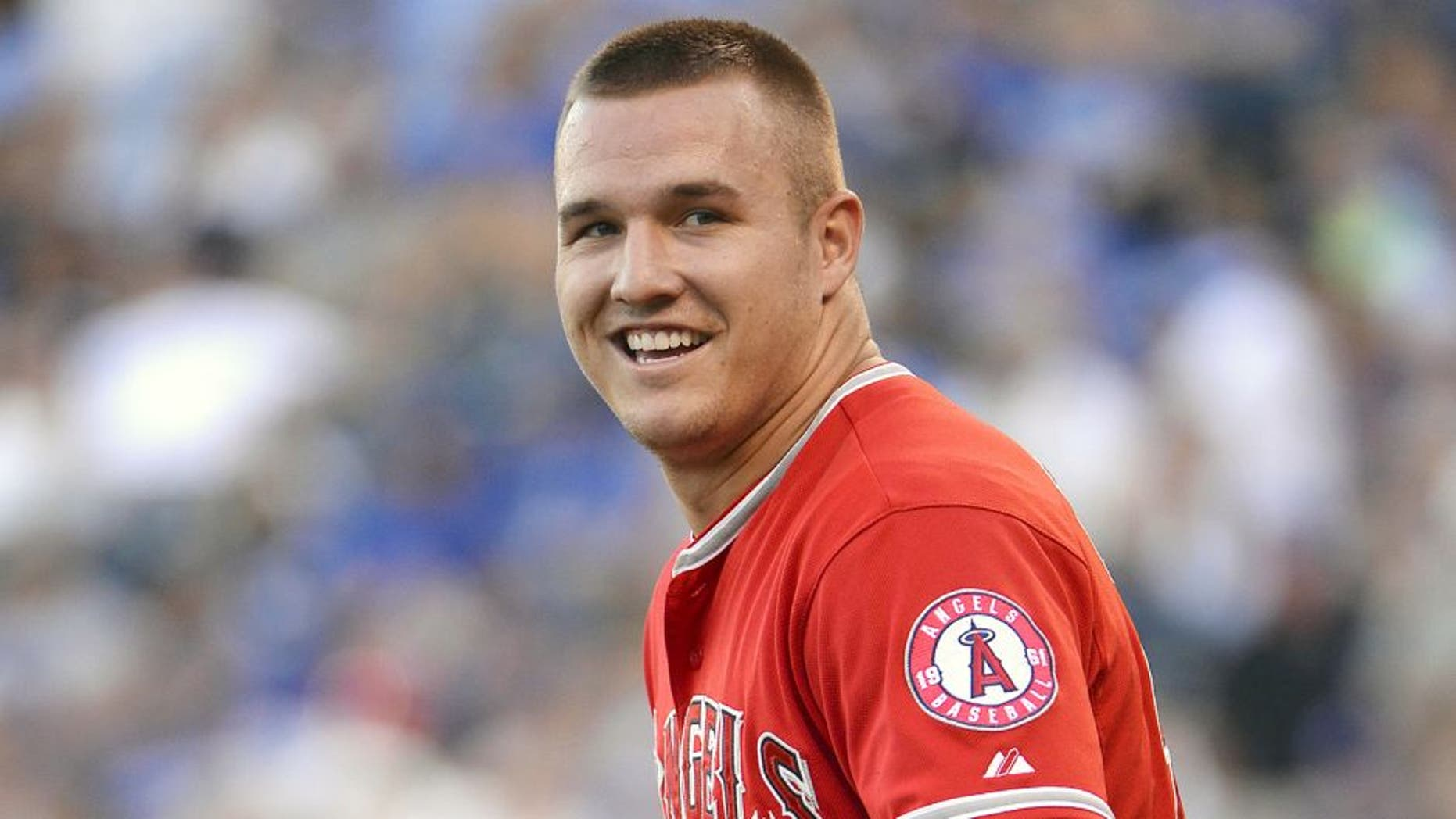 Aug 13, 2015; Kansas City, MO, USA; Los Angeles Angels center fielder Mike Trout (27) walks to the outfield in the first inning against the Kansas City Royals at Kauffman Stadium. Mandatory Credit: John Rieger-USA TODAY Sports