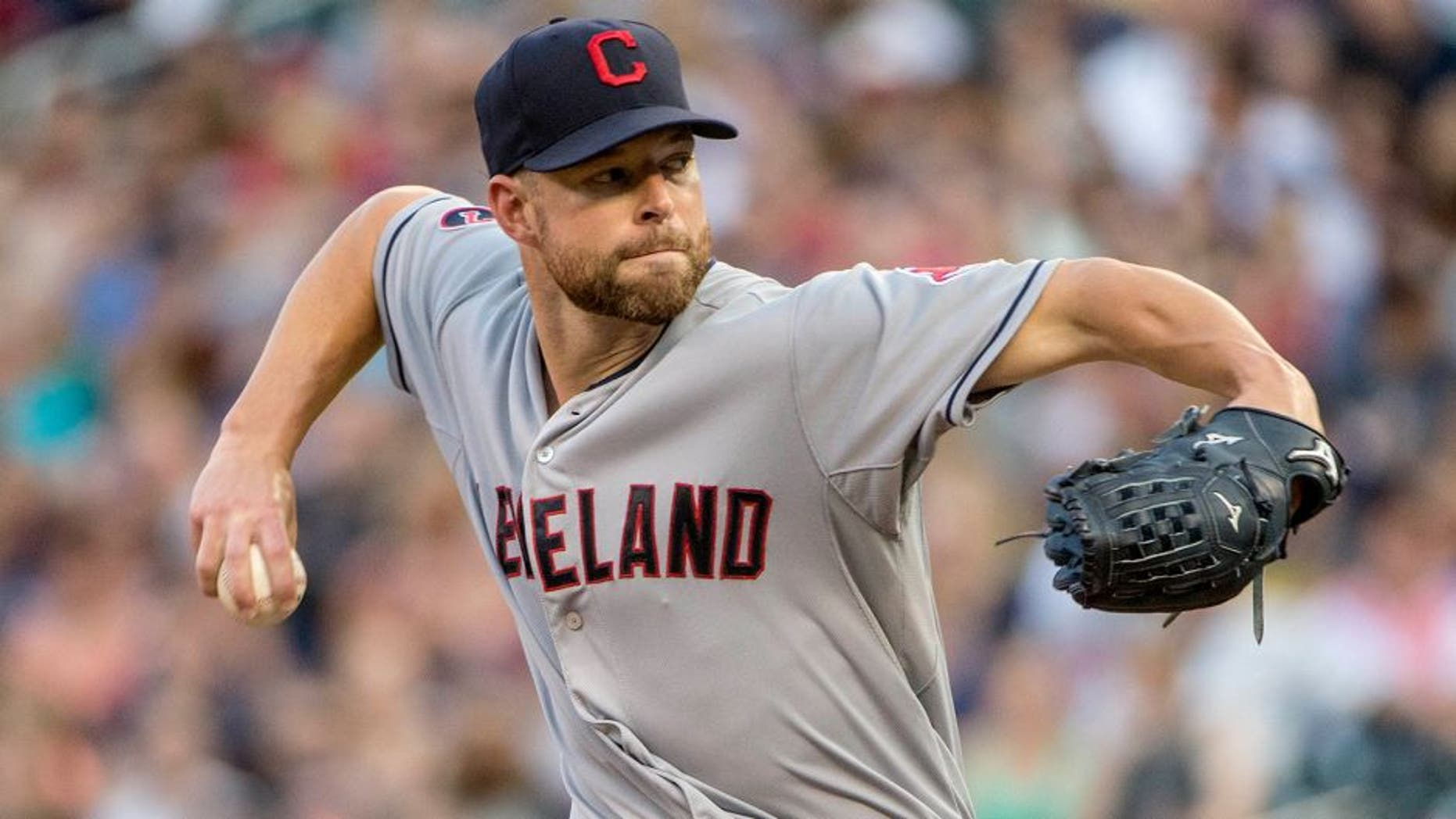 Aug 14, 2015; Minneapolis, MN, USA; Cleveland Indians starting pitcher Corey Kluber (28) delivers a pitch in the first inning against the Minnesota Twins at Target Field. Mandatory Credit: Jesse Johnson-USA TODAY Sports