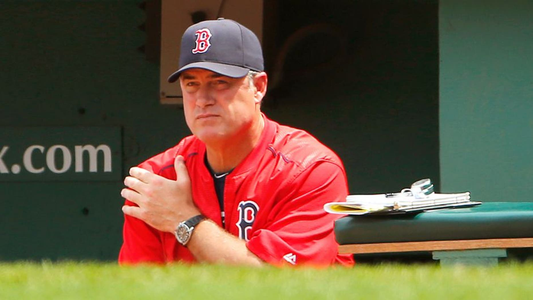 BOSTON, MA - JUNE 25: Manager John Farrell #53 of the Boston Red Sox in the dugout during the fourth inning in a game against the Baltimore Orioles at Fenway Park on June 25, 2015 in Boston, Massachusetts. (Photo by Winslow Townson/Getty Images)