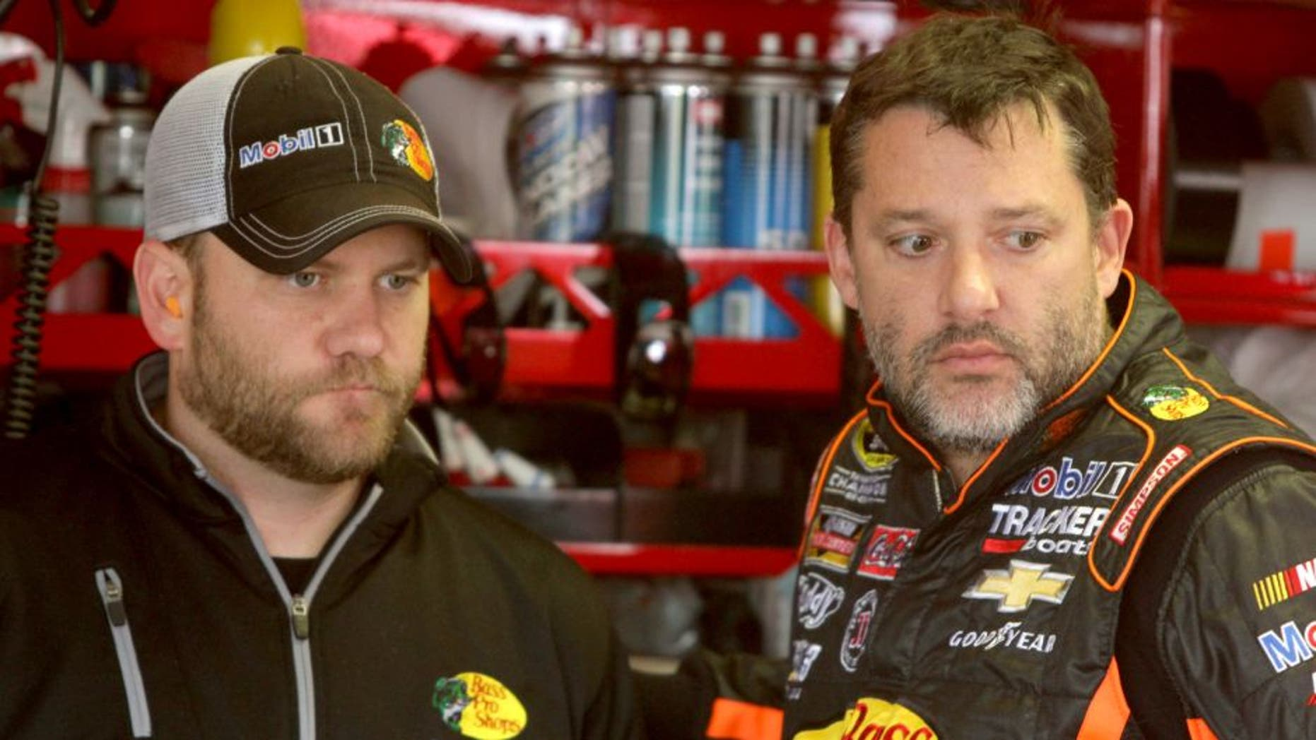 Tony Stewart, driver of the #14 Mobil 1/Bass Pro Shops Chevrolet, speaks with his crew chief Chad Johnston during practice for the NASCAR Sprint Cup Series Bojangles' Southern 500 at Darlington Raceway on April 11, 2014 in Darlington, South Carolina. (Photo by Jerry Markland/Getty Images)