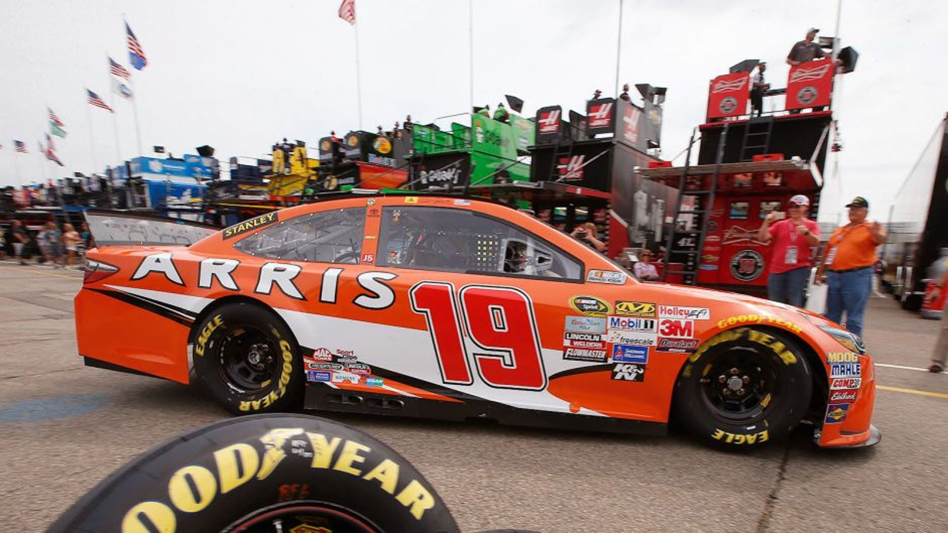 BROOKLYN, MI - AUGUST 14: Carl Edwards, driver of the #19 ARRIS Toyota, drives through the garage area during practice for the NASCAR Sprint Cup Series Pure Michigan 400 at Michigan International Speedway on August 14, 2015 in Brooklyn, Michigan. (Photo by Gregory Shamus/Getty Images)