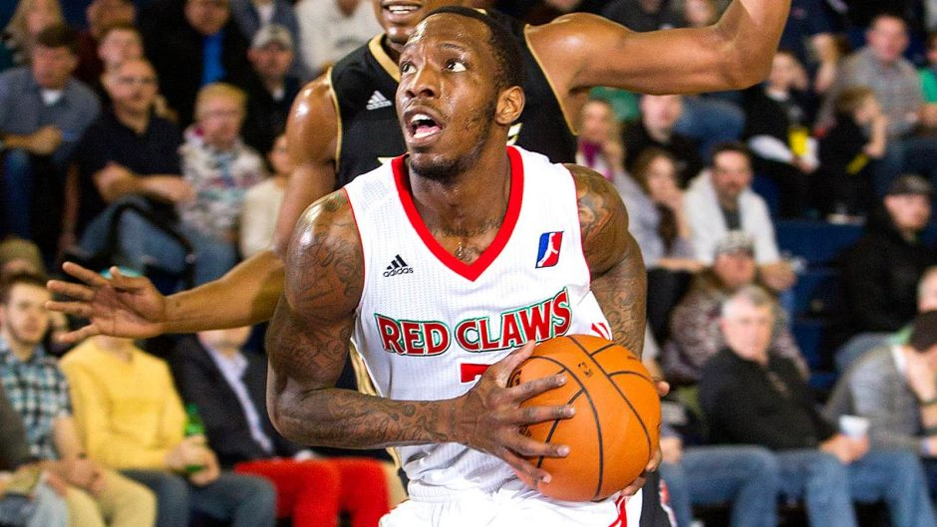 PORTLAND, ME - MARCH 16: Tyshawn Taylor #7 of the Maine Red Claws drives against the Erie BayHawks on March 16, 2014 at the Portland Expo in Portland, Maine. NOTE TO USER: User expressly acknowledges and agrees that, by downloading and/or using this photograph, user is consenting to the terms and conditions of the Getty Images License Agreement. Mandatory Copyright Notice: Copyright 2014 NBAE (Photo by Rich Obrey/NBAE via Getty Images)