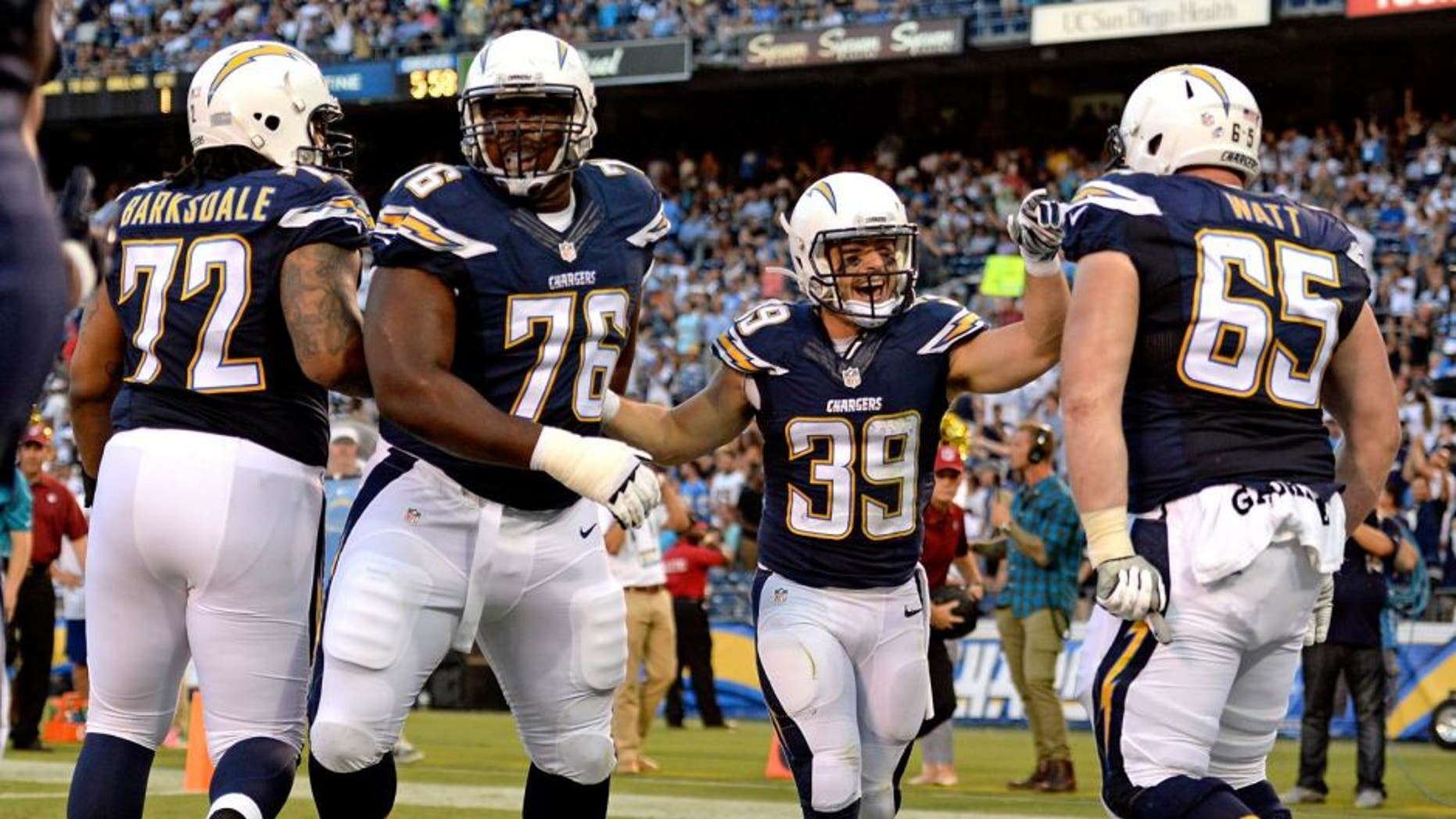Aug 13, 2015; San Diego, CA, USA; San Diego Chargers running back Danny Woodhead (39) is congratulated by teammates after running for a touchdown during the first quarter against the Dallas Cowboys in a preseason NFL football game at Qualcomm Stadium. Mandatory Credit: Jake Roth-USA TODAY Sports