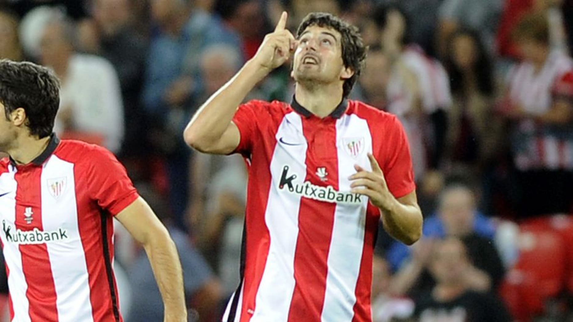 Athletic Bilbao's defender Mikel San Jose celebrates after scoring during the Spanish Supercup first-leg football match Athletic Club Bilbao vs FC Barcelona at the San Mames stadium in Bilbao on August 14, 2015. AFP PHOTO/ ANDER GILLENEA (Photo credit should read ANDER GILLENEA/AFP/Getty Images)