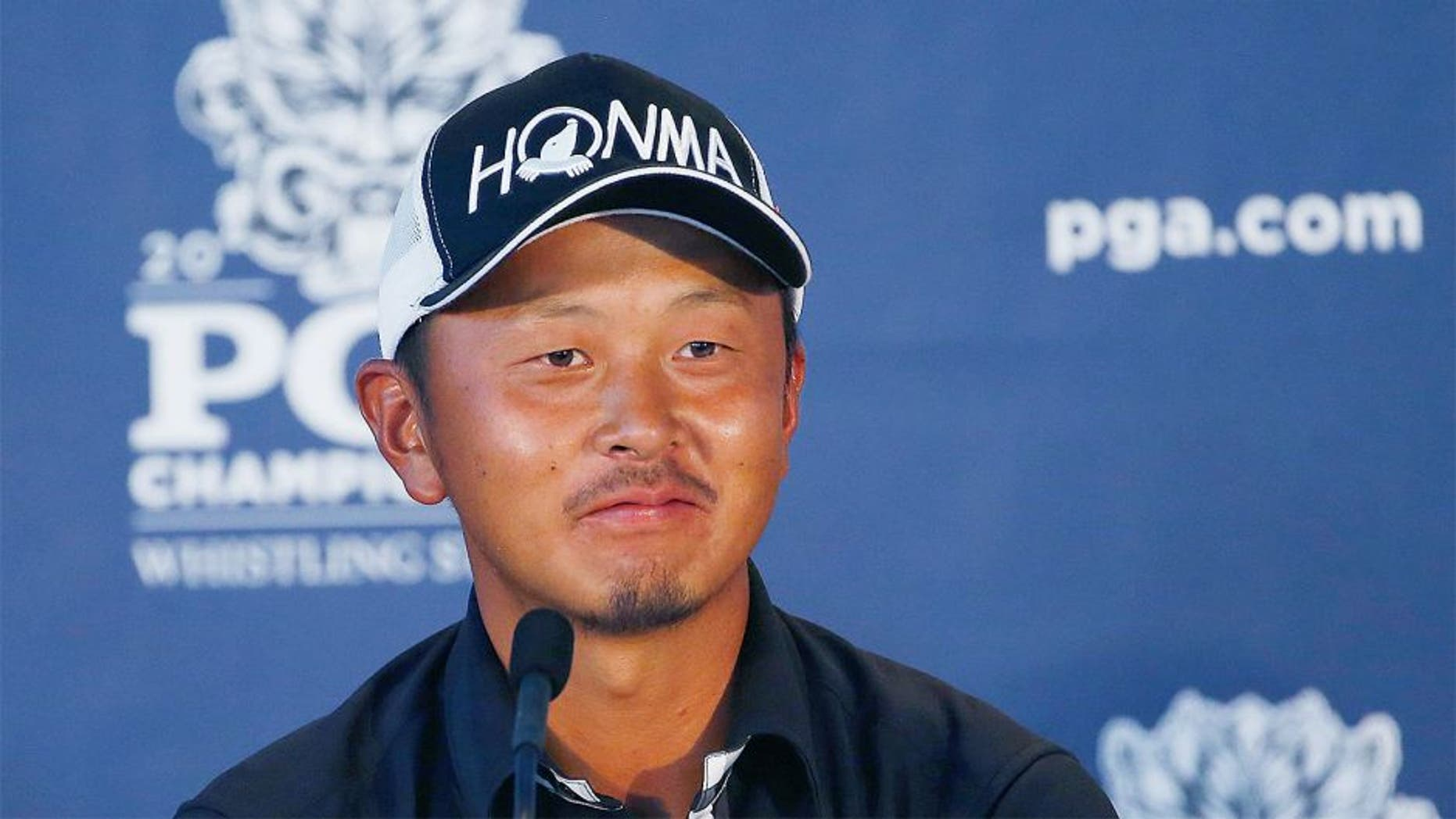 SHEBOYGAN, WI - AUGUST 14: Hiroshi Iwata of Japan speaks with the media after shooting a nine-under par 63 during the second round of the 2015 PGA Championship at Whistling Straits on August 14, 2015 in Sheboygan, Wisconsin. (Photo by Jamie Squire/Getty Images)
