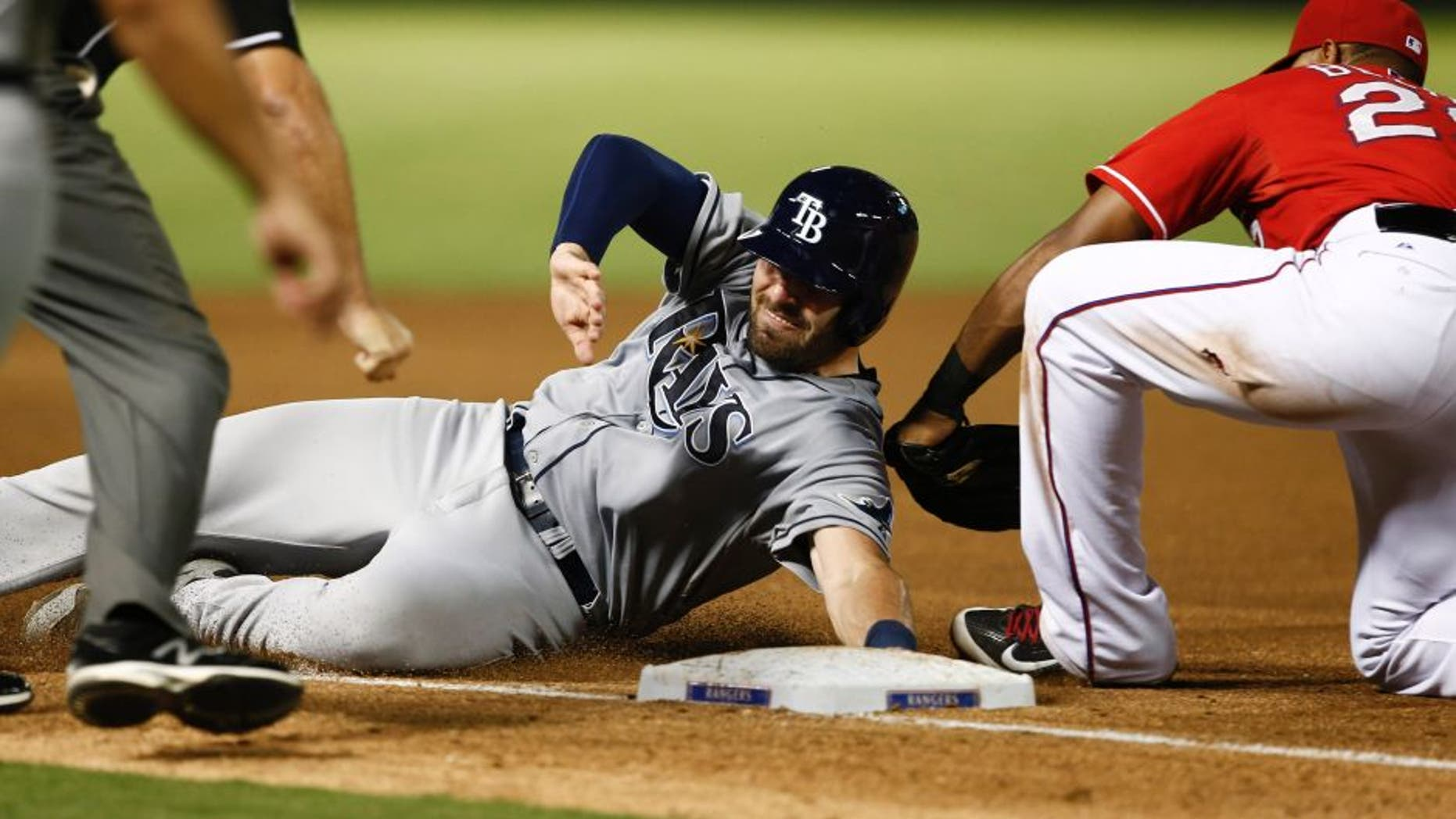 Aug 14, 2015; Arlington, TX, USA; Texas Rangers third baseman Adrian Beltre (29) tags out Tampa Bay Rays catcher Curt Casali (19) during the seventh inning of a baseball game at Globe Life Park in Arlington. The Rangers won 5-3. Mandatory Credit: Jim Cowsert-USA TODAY Sports