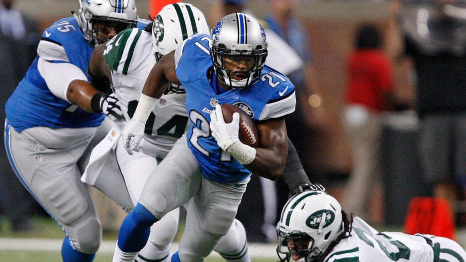 Aug 13, 2015; Detroit, MI, USA; Detroit Lions running back Ameer Abdullah (21) evades a tackle from New York Jets free safety Calvin Pryor (25) during the first quarter of a preseason NFL football game at Ford Field. Mandatory Credit: Raj Mehta-USA TODAY Sports
