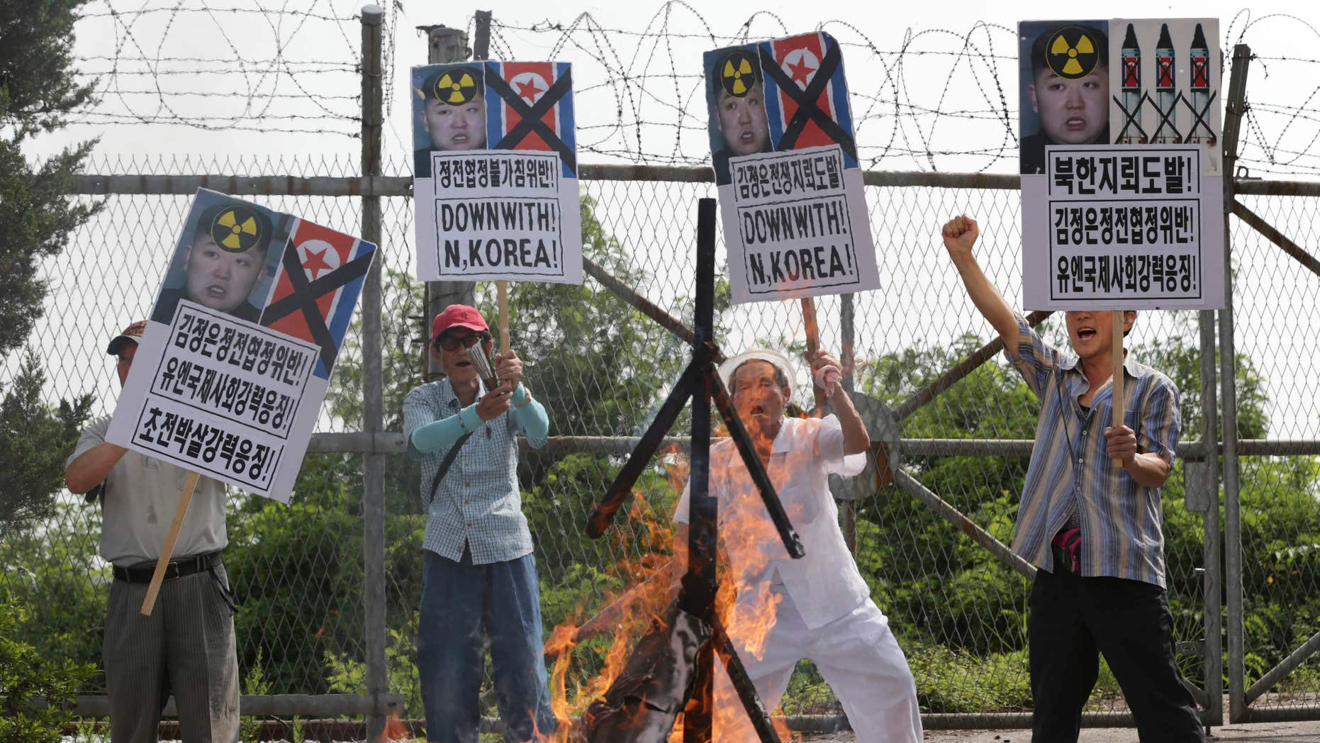 Aug. 11, 2015: Members of South Korean conservative group shout slogans after burning an effigy of North Korean leader Kim Jong Un and North Korean flags during a rally denouncing the North Korea at the Imjingak Pavilion near the border village of Panmunjom in Paju, South Korea.