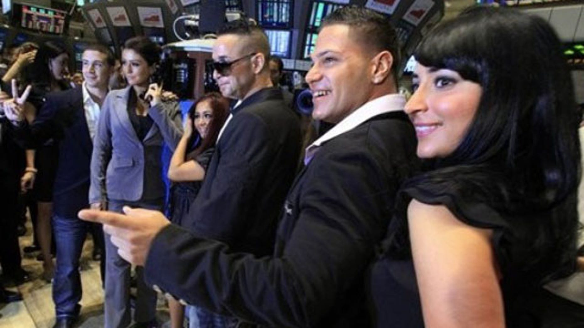"""July 27: Cast members of MTV's """"Jersey Shore"""" reality series pose for photos after ringing the opening bell of the New York Stock Exchange. They are, from left: Vinny Guadagnino; Jenni """"J-Woww"""" Farley; Nicole """"Snooki"""" Polizzi; Michael """"The Situation"""" Sorrentino; Ronnie Ortiz; Angelina """"Jolie"""" Pivarnick. (AP Photo/Richard Drew)"""