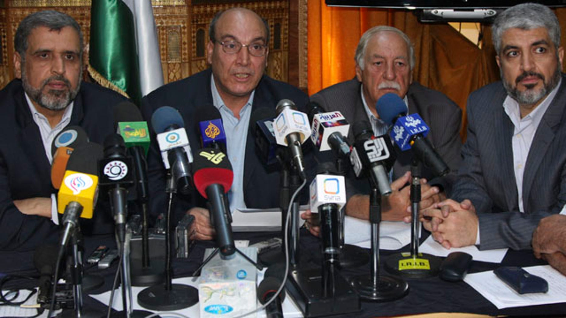 Aug. 15: Eleven Damascus-based opposition Palestinian groups gather in Damascus, Syria, to agree on a united stance towards direct negotiations between Israel and the Palestinian Authority, with from the right, Khaled Mashaal, head of Hamas politburo; Ahmed Jibril, the Popular Front for the Liberation of Palestine General Command;  Maher Taher, the Popular Front for the Liberation of Palestine's representative in Damascus; and Ramadan Shallah, the secretary general of the Islamic Jihad leader.