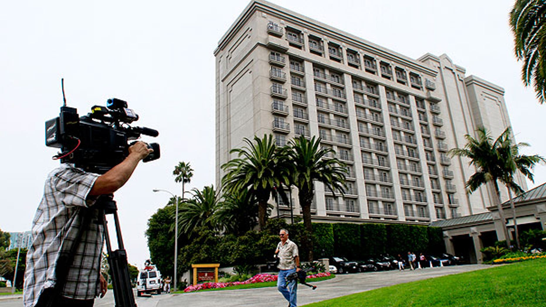 """Aun. 14: A photographer shoots outside the Ritz Carlton in Marina del Rey, Calif. where a Rembrandt drawing believed to be called """"The Judgement"""" was stolen Saturday evening from a private art exhibit."""