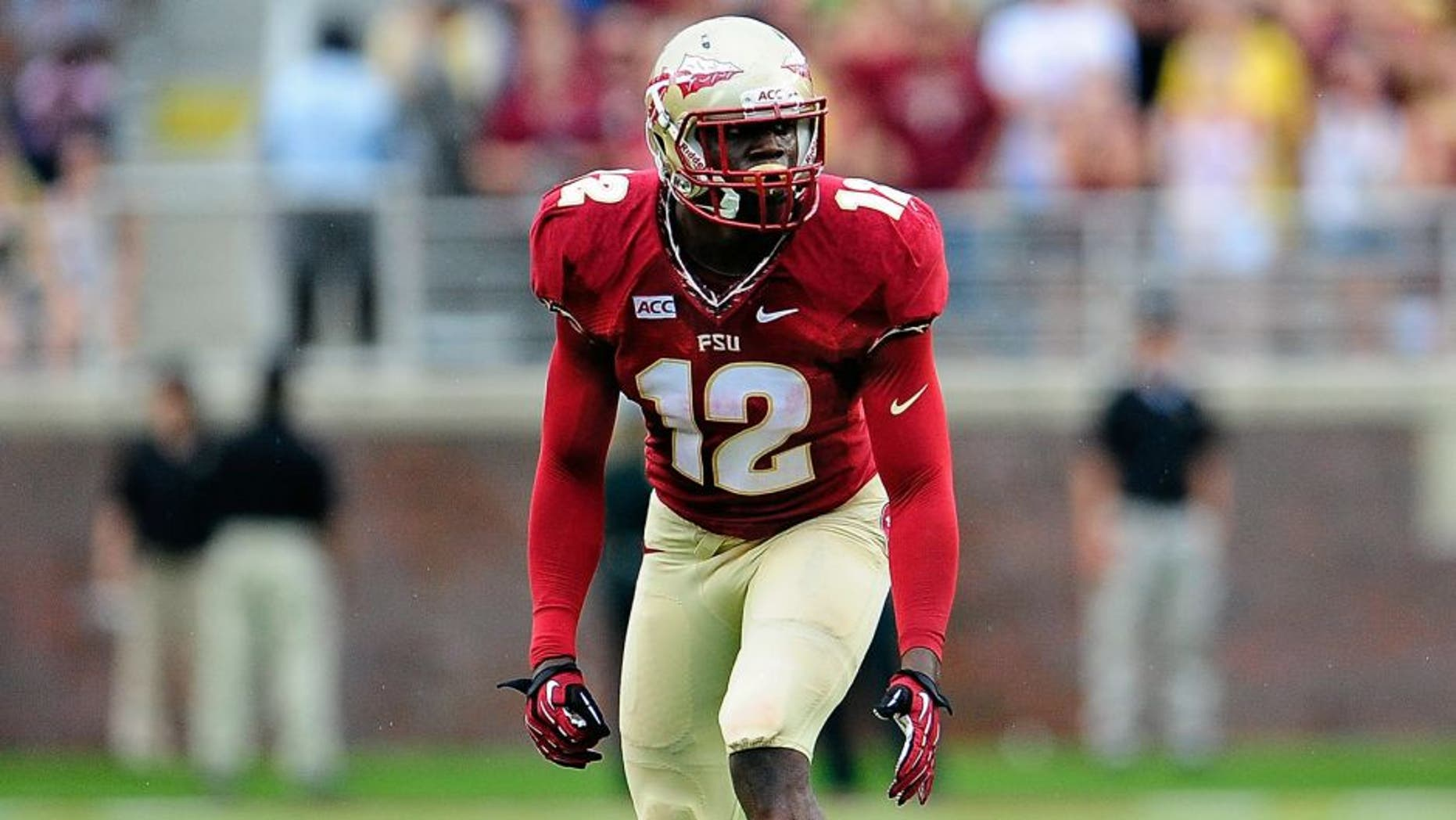 TALLAHASSEE, FL - SEPTEMBER 21: Matthew Thomas #12 of the Florida State Seminoles prepares for a play against the Bethune-Cookman Wildcats during a game at Doak Campbell Stadium on September 21, 2013 in Tallahassee, Florida. Florida State won the game 54-6. (Photo by Stacy Revere/Getty Images)