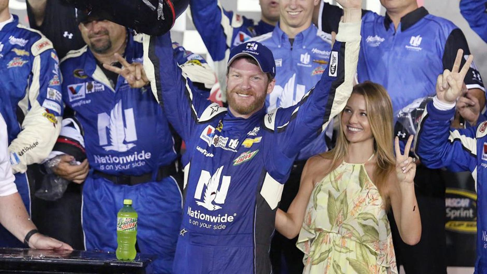 Dale Earnhardt Jr. celebrates in Victory Lane after winning the Coke Zero 400 NASCAR Sprint Cup race at Daytona International Speedway on Sunday, July 5, 2015 in Daytona Beach, Fla. (Stephen M. Dowell/Orlando Sentinel/TNS via Getty Images)