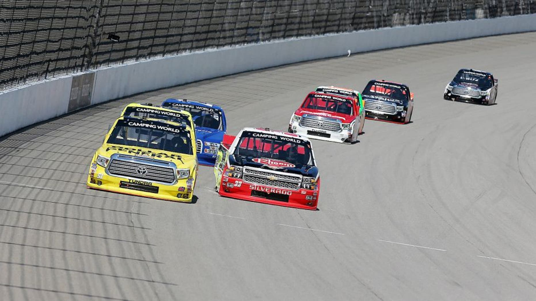BROOKLYN, MI - AUGUST 15: Kyle Busch, driver of the #51 Dollar General Toyota, races Austin Dillon, driver of the #33 Rheem/Young Supply Company Chevrolet, during the NASCAR Camping World Truck Series Careers for Veterans 200 at Michigan International Speedway on August 15, 2015 in Brooklyn, Michigan. (Photo by Nick Laham/NASCAR via Getty Images)