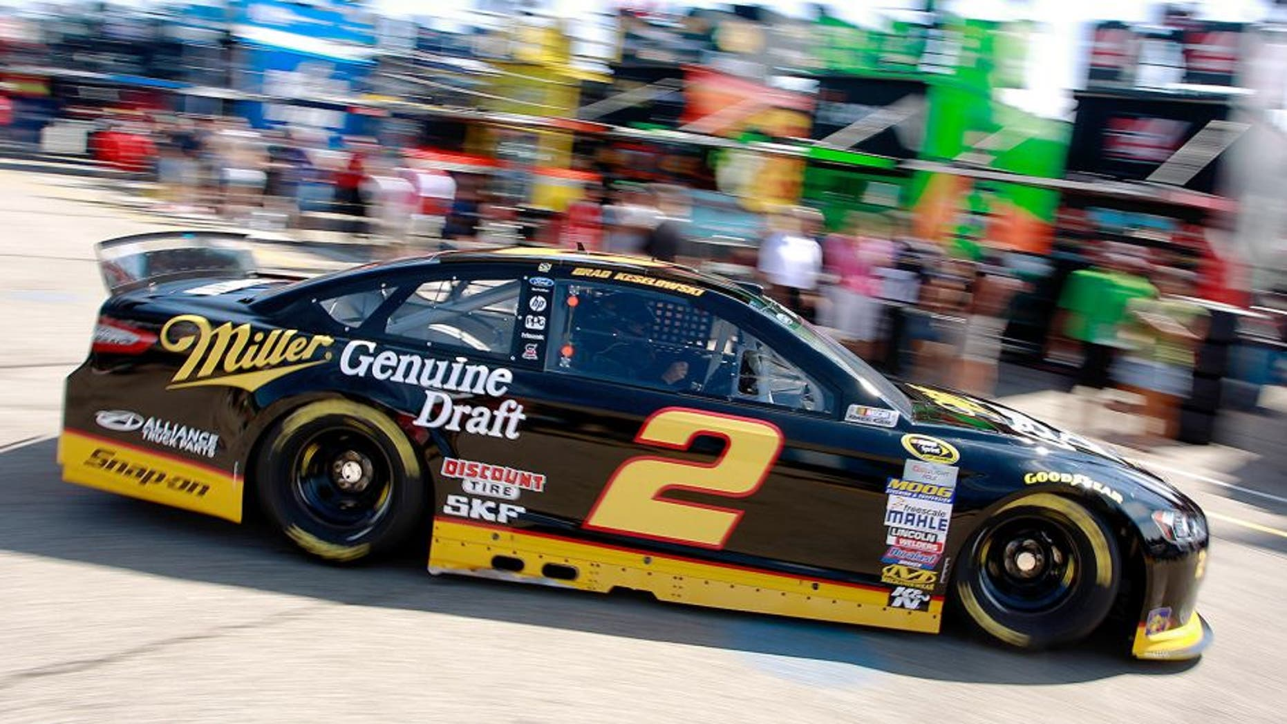 BROOKLYN, MI - AUGUST 15: Brad Keselowski, driver of the #2 Miller Lite Ford, drives through the garage area during practice for the NASCAR Sprint Cup Series Pure Michigan 400 at Michigan International Speedway on August 15, 2015 in Brooklyn, Michigan. (Photo by Brian Lawdermilk/NASCAR via Getty Images)