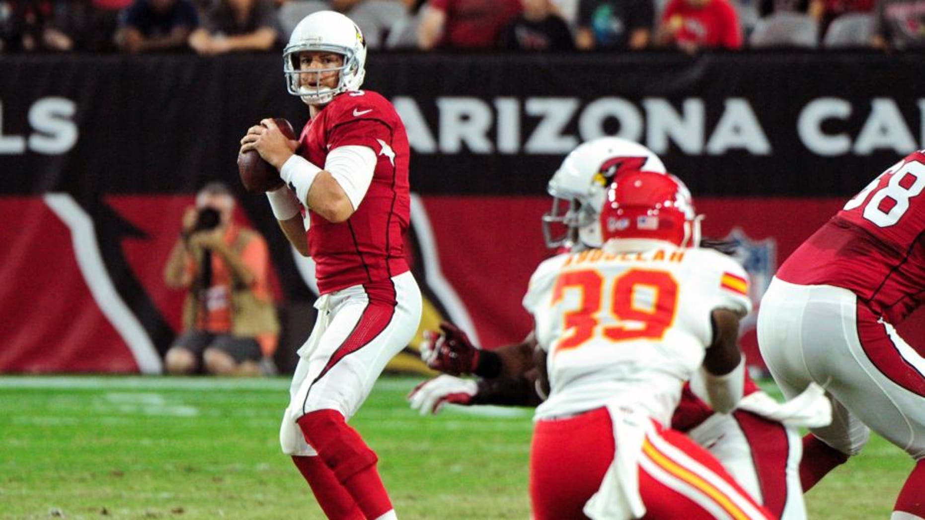 Aug 15, 2015; Glendale, AZ, USA; Arizona Cardinals quarterback Carson Palmer (3) looks to pass during the first half against the Kansas City Chiefs in a preseason NFL football game at University of Phoenix Stadium. Mandatory Credit: Matt Kartozian-USA TODAY Sports