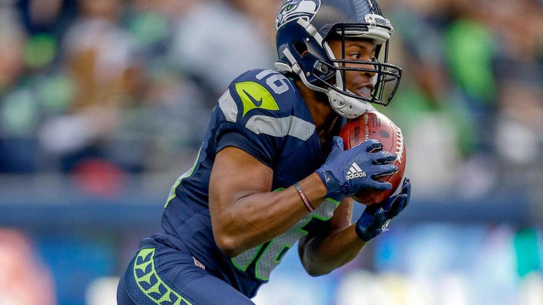 SEATTLE, WA - AUGUST 14: Kick returner Tyler Lockett #16 of the Seattle Seahawks returns a kickoff for a touchdown against the Denver Broncos at CenturyLink Field on August 14, 2015 in Seattle, Washington. (Photo by Otto Greule Jr/Getty Images)