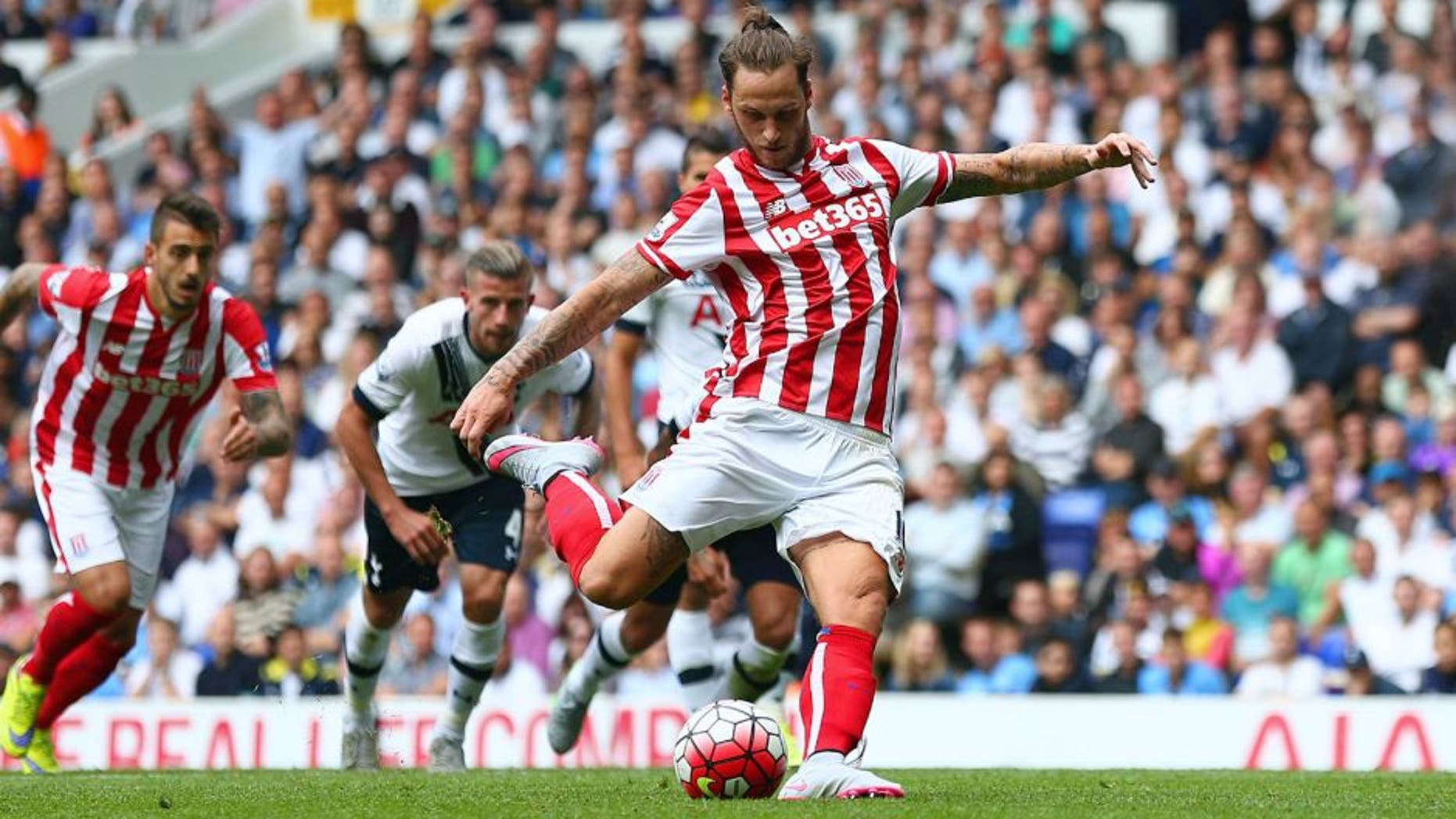 LONDON, ENGLAND - AUGUST 15: Marko Arnautovic of Stoke City scores his team's first goal from the penalty spot during the Barclays Premier League match between Tottenham Hotspur and Stoke City at White Hart Lane on August 15, 2015 in London, United Kingdom. (Photo by Dan Mullan/Getty Images)