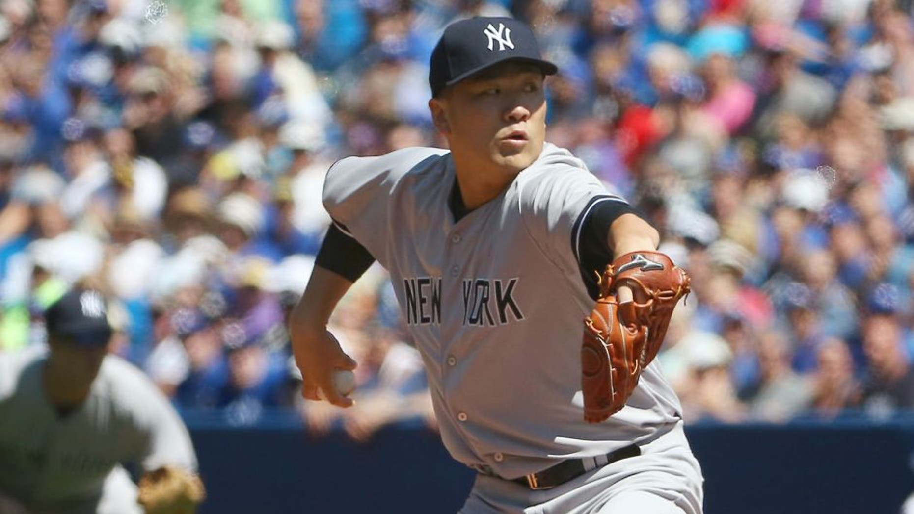 Masahiro Tanaka #19 of the New York Yankees delivers a pitch in the first inning during MLB game action against the Toronto Blue Jays on August 15, 2015 at Rogers Centre in Toronto, Ontario, Canada. (Photo by Tom Szczerbowski/Getty Images)