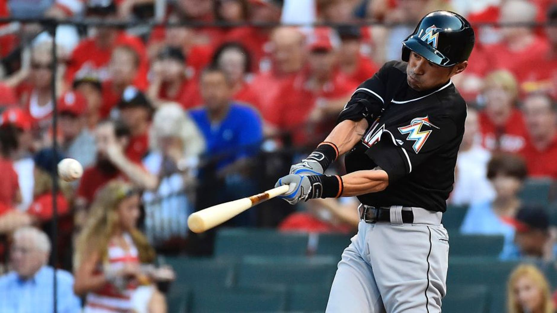 Aug 15, 2015; St. Louis, MO, USA; Miami Marlins left fielder Ichiro Suzuki (51) hits a single off of St. Louis Cardinals starting pitcher John Lackey (not pictured) in the first inning at Busch Stadium. Mandatory Credit: Jasen Vinlove-USA TODAY Sports