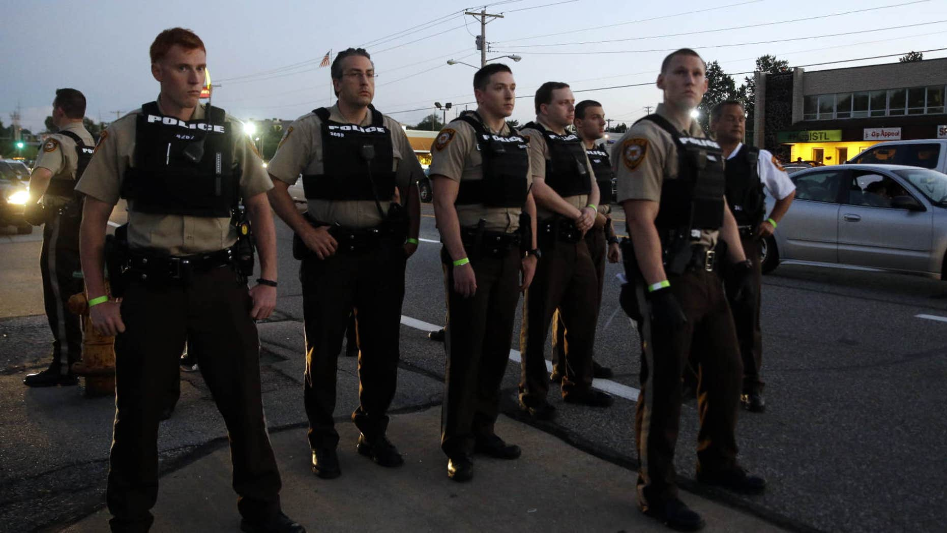 Aug. 10, 2015: Police patrol in Ferguson, Mo