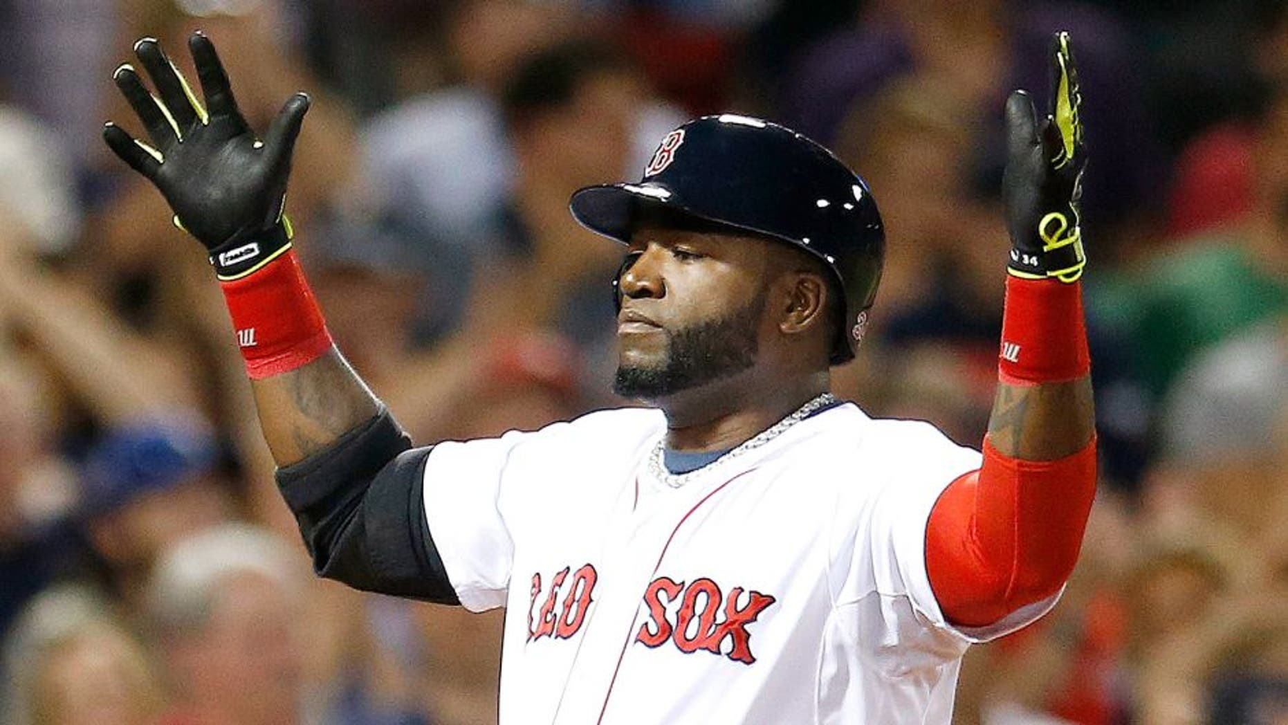 Boston Red Sox's David Ortiz celebrates his two-run home run during the third inning of a baseball game against the Houston Astros in Boston, Saturday, Aug. 16, 2014. (AP Photo/Michael Dwyer)
