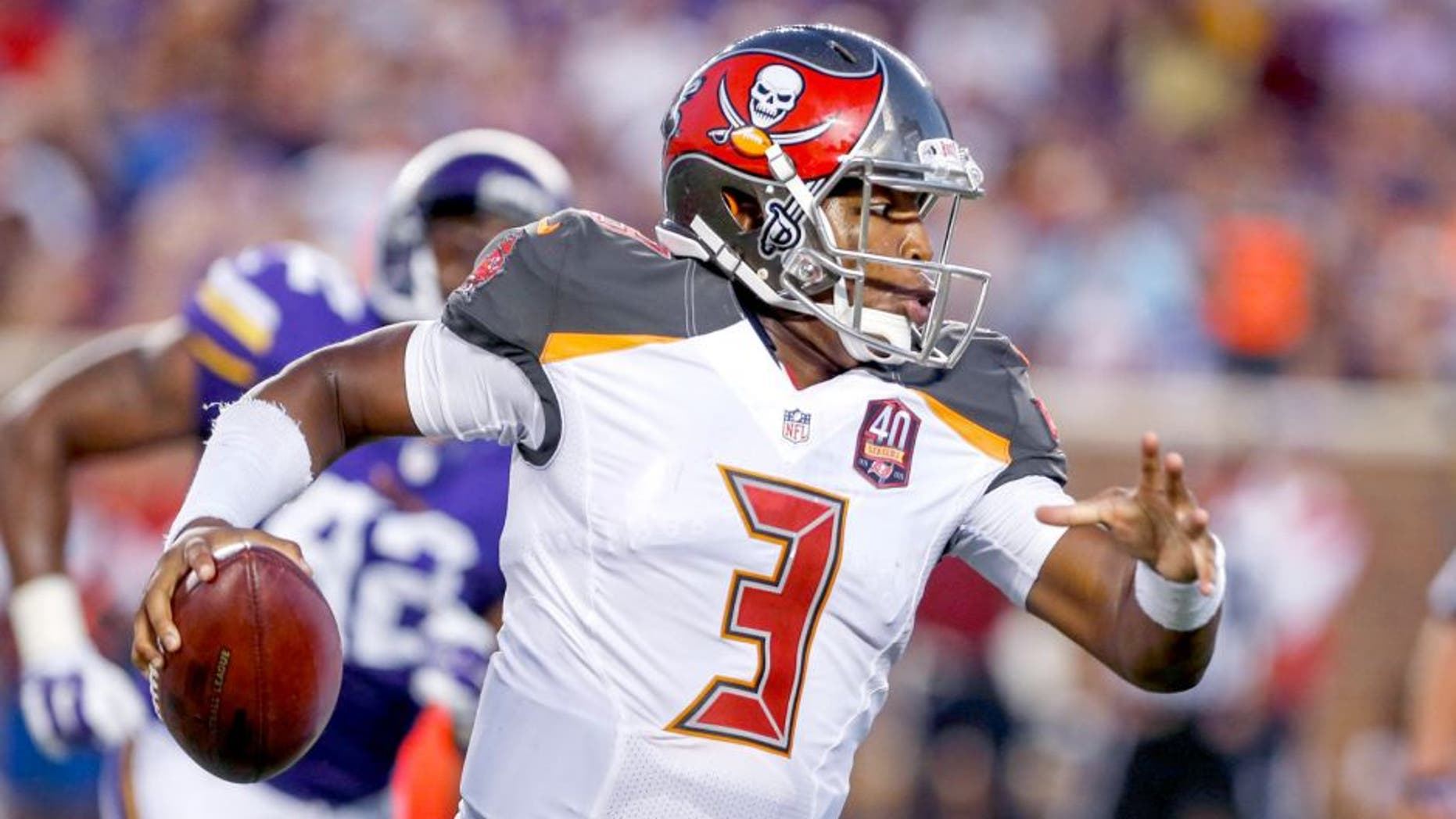 Aug 15, 2015; Minneapolis, MN, USA; Tampa Bay Buccaneers quarterback Jameis Winston (3) rushes for an 8 yard touchdown against the Minnesota Vikings in the second quarter of a preseason NFL football game at TCF Bank Stadium. The Vikings won 26-16. Mandatory Credit: Bruce Kluckhohn-USA TODAY Sports