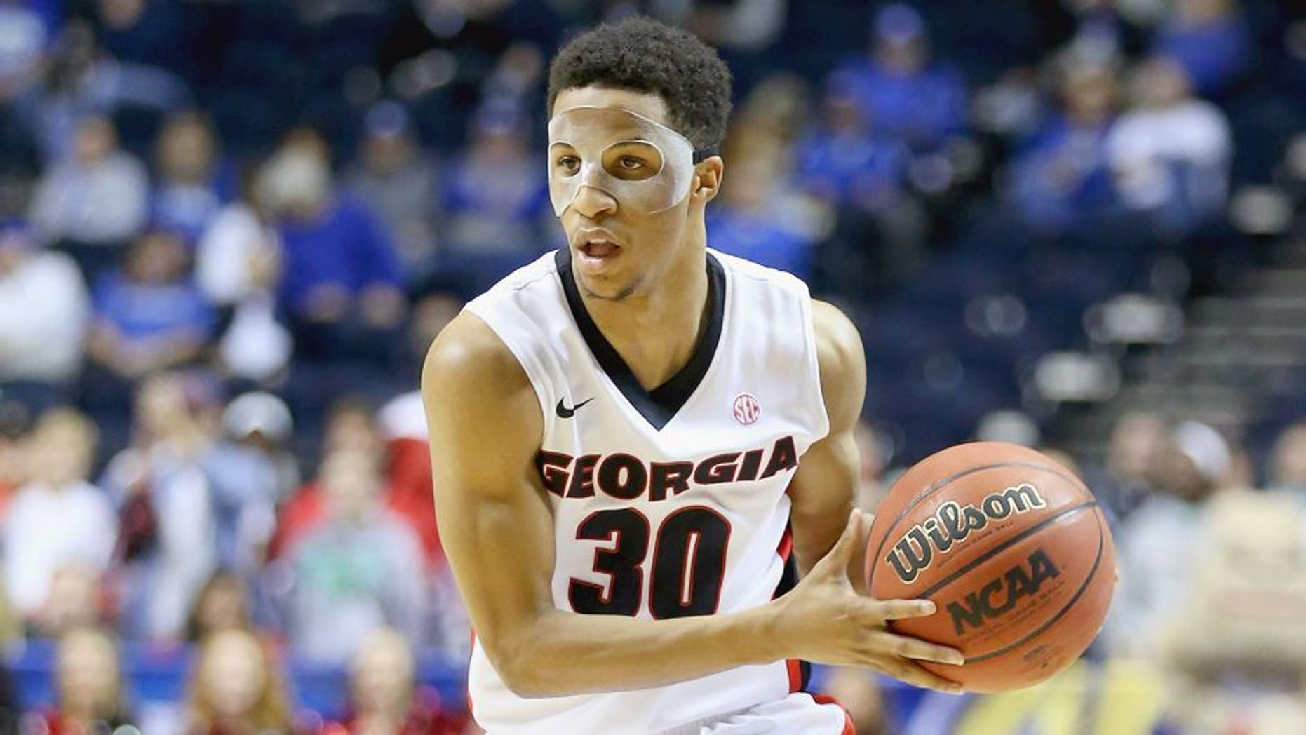 NASHVILLE, TN - MARCH 13: J.J. Frazier #30 of the Georgia Bulldogs passes the ball against the South Carolina Gamecocks during the quarterfinals of the SEC Basketball Tournament at Bridgestone Arena on March 13, 2015 in Nashville, Tennessee. (Photo by Andy Lyons/Getty Images)