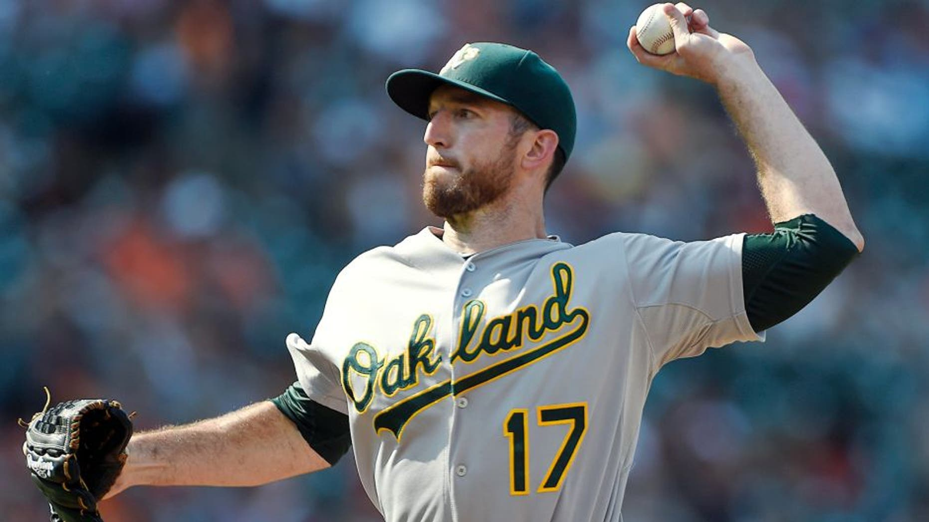 Aug 16, 2015; Baltimore, MD, USA; Oakland Athletics first baseman Ike Davis (17) pitches during the eighth inning against the Baltimore Orioles at Oriole Park at Camden Yards. The Orioles won 18-2. Mandatory Credit: Tommy Gilligan-USA TODAY Sports