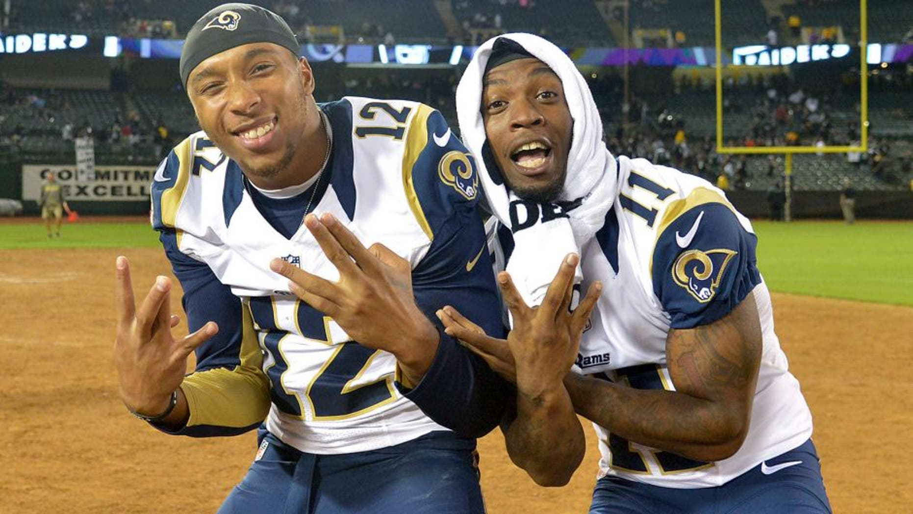 Aug 14, 2015; Oakland, CA, USA; St. Louis Rams receivers Stedman Bailey (12) and Tavon Austin (11) pose after the preseason NFL game against the Oakland Raiders at O.co Coliseum. Mandatory Credit: Kirby Lee-USA TODAY Sports