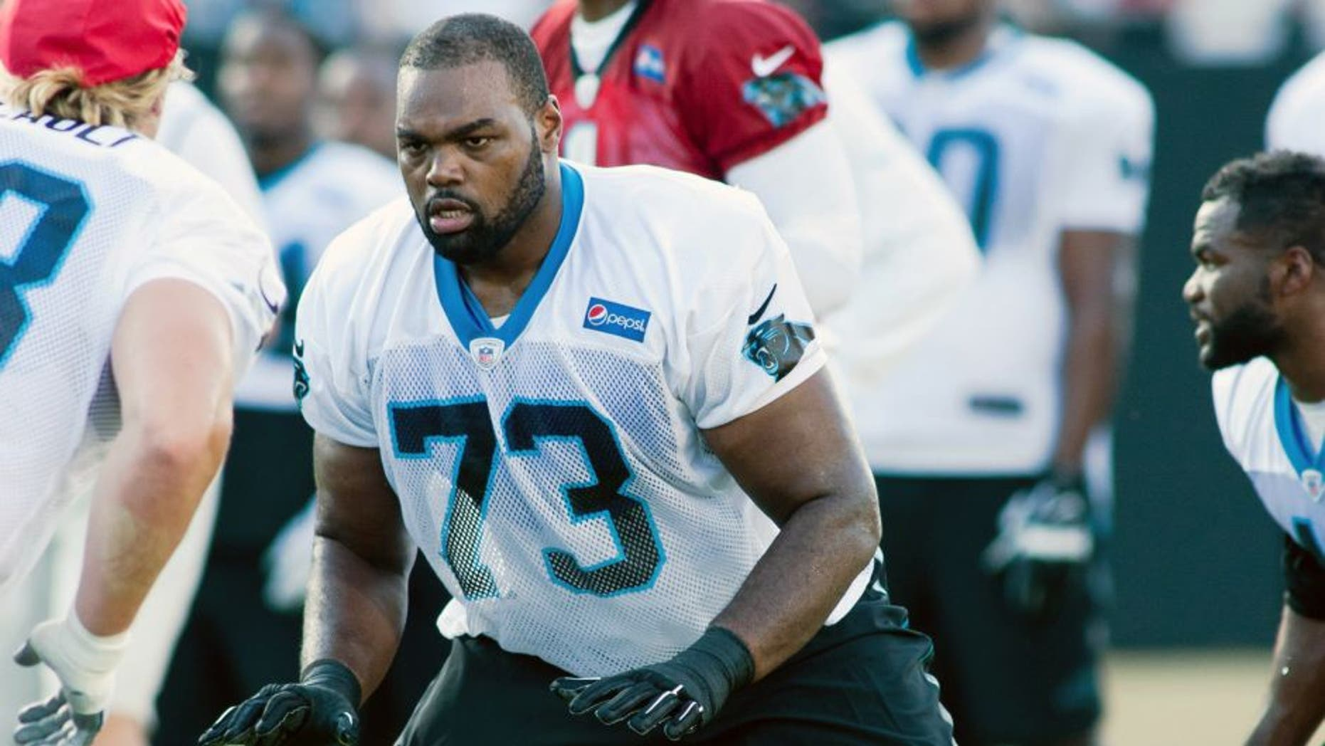 Jul 31, 2015; Spartanburg, SC, USA; Carolina Panthers tackle Michael Oher (73) looks to block during a drill in training camp held at Wofford College. Mandatory Credit: Jeremy Brevard-USA TODAY Sports
