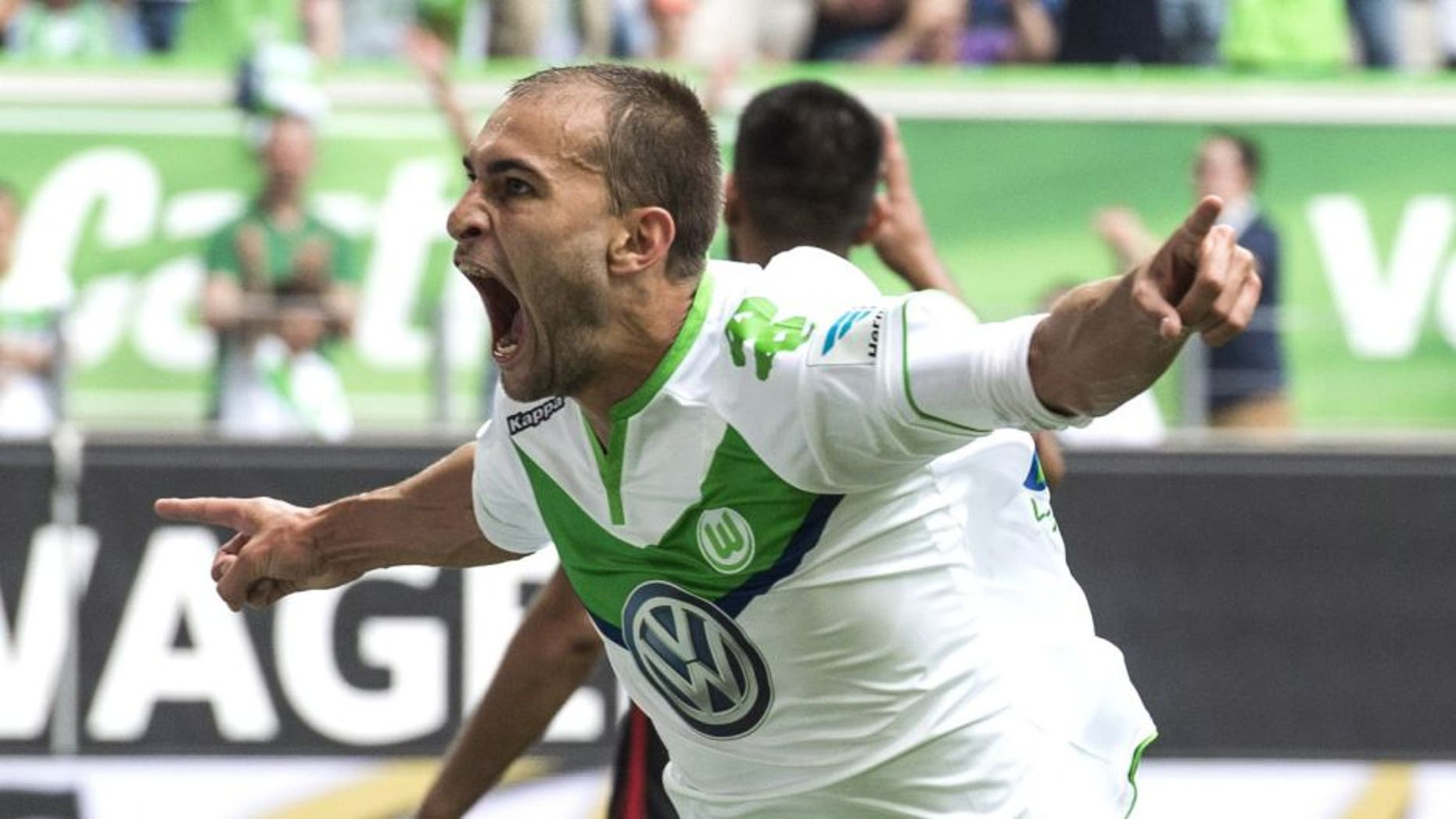 Wolfsburg's Dutch striker Bas Dost celebrates after scoring a second goal for Wolfsburg during the German first division Bundesliga football match VfL Wolfsburg vs Eintracht Frankfurt in Wolfsburg, northern Germany, on August 16, 2015. AFP PHOTO / JOHN MACDOUGALL RESTRICTIONS: DURING MATCH TIME: DFL RULES TO LIMIT THE ONLINE USAGE TO 15 PICTURES PER MATCH AND FORBID IMAGE SEQUENCES TO SIMULATE VIDEO. == RESTRICTED TO EDITORIAL USE == FOR FURTHER QUERIES PLEASE CONTACT DFL DIRECTLY AT + 49 69 650050. (Photo credit should read JOHN MACDOUGALL/AFP/Getty Images)