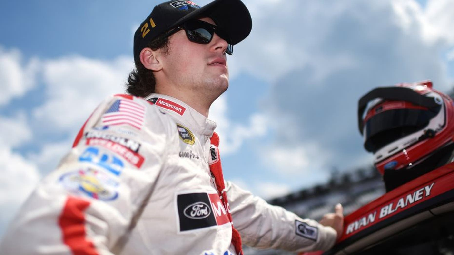 LONG POND, PA - JULY 29: Ryan Blaney, driver of the #21 Motorcraft/Quick Lane Tire & Auto Center Ford stands on the grid during qualifying for the NASCAR Sprint Cup Series Pennsylvania 400 at Pocono Raceway on July 29, 2016 in Long Pond, Pennsylvania. (Photo by Rainier Ehrhardt/NASCAR via Getty Images)
