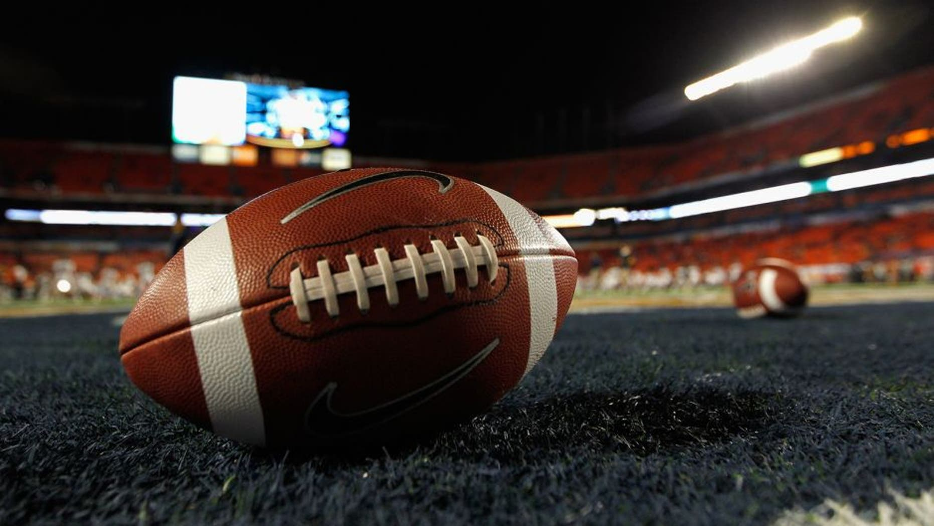 MIAMI GARDENS, FL - JANUARY 04: A detail of a Nike official NCAA size football as it sits in the end zone while the West Virginia Mountaineers stretchon the field prior to playing against the Clemson Tigers during the Discover Orange Bowl at Sun Life Stadium on January 4, 2012 in Miami Gardens, Florida. (Photo by Streeter Lecka/Getty Images)