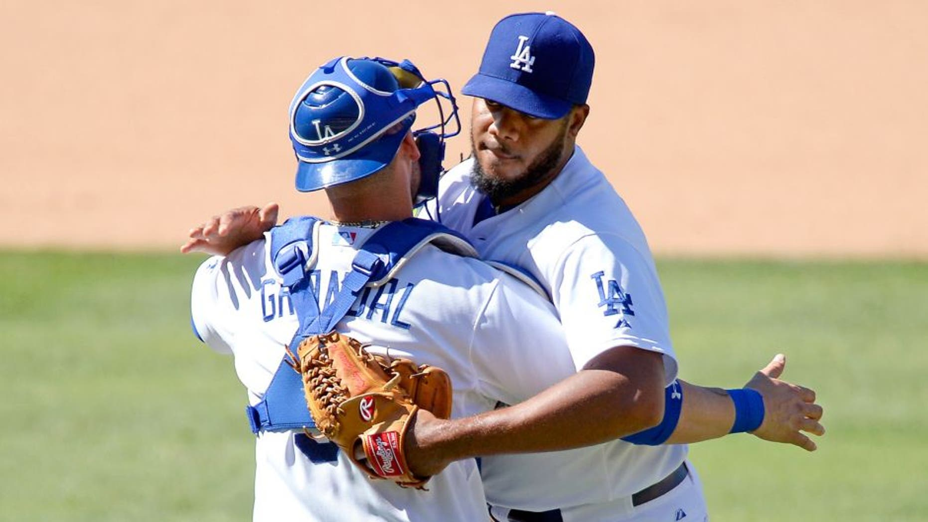 LOS ANGELES, CA - AUGUST 16: Closer Kenley Jansen #74 and catcher Yasmani Grandal #9 of the Los Angeles Dodgers celebrate after defeating the Cincinnati Reds, 2-1, at Dodger Stadium August 16, 2015, in Los Angeles, California. (Photo by Kevork Djansezian/Getty Images)