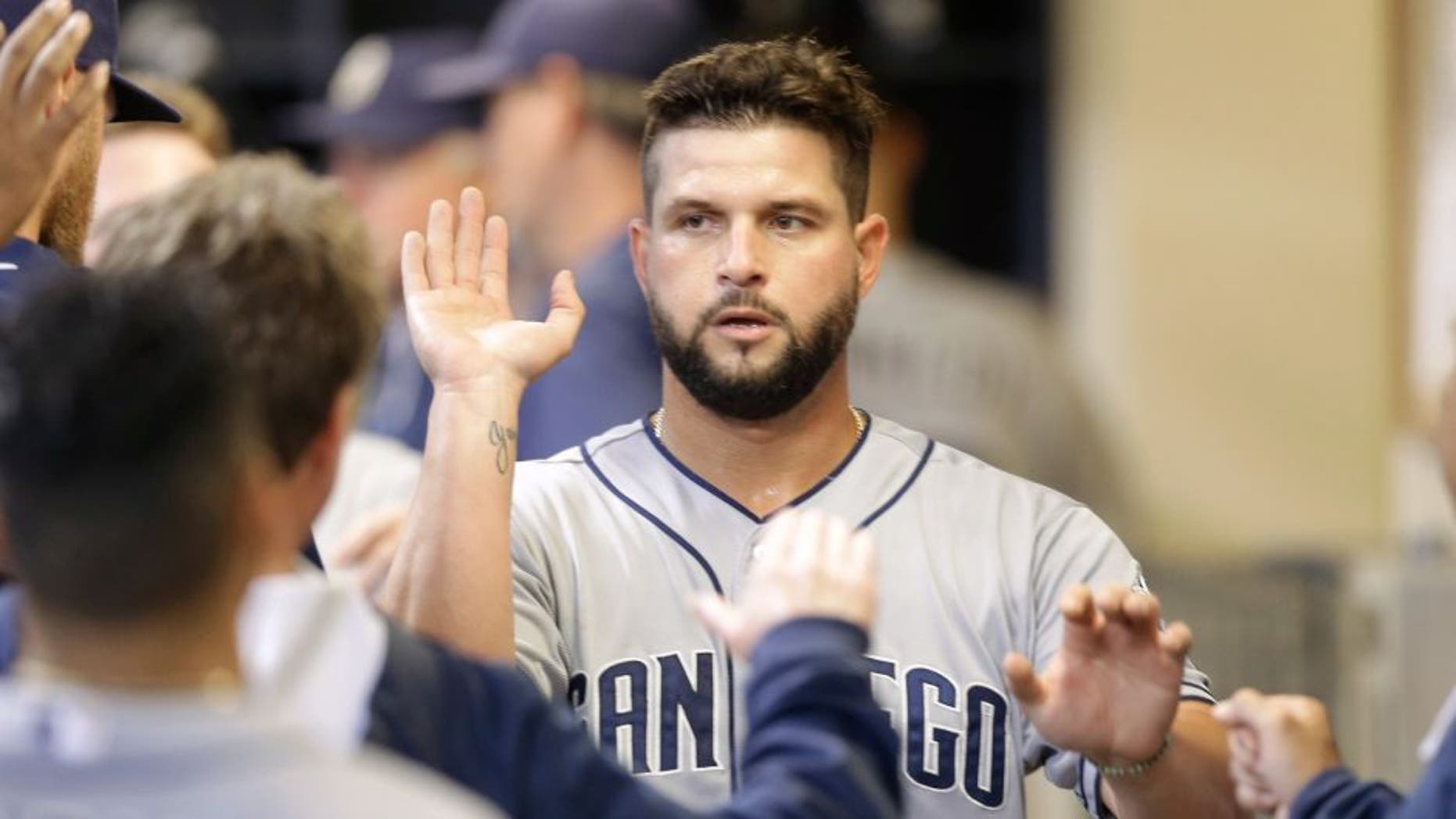 MILWAUKEE, WI - AUGUST 05: Yonder Alonso #23 of the San Diego Padres celebrates after reach home plate on a RBI single hit by Will Venable in the seventh inning against the Milwaukee Brewers at Miller Park on August 05, 2015 in Milwaukee, Wisconsin. (Photo by Mike McGinnis/Getty Images)
