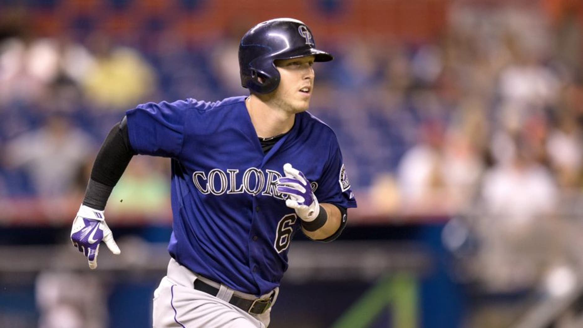 MIAMI, FL - JUNE 11: Corey Dickerson #6 of the Colorado Rockies runs to first base during the game against the Miami Marlins at Marlins Park on June 11, 2015 in Miami, Florida. (Photo by Rob Foldy/Getty Images)